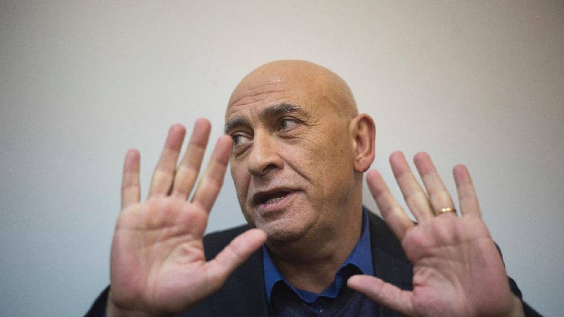 FILE -- This Dec. 26, 2016 file photo, shows Arab Israeli lawmaker Basel Ghattas in a magistrate court, in Rishon Lezion, Israel. Ghattas, a former Arab lawmaker has been sentenced to two years in prison after admitting to smuggling cellphones to Palestinian prisoners held by Israel. An Israeli court on Sunday accepted a plea bargain between Basel Ghattas and prosecutors. As part of the deal, Ghattas, a member of the Joint List of Arab parties, agreed to resign from parliament last month. (AP Photo/Ariel Schalit, File)