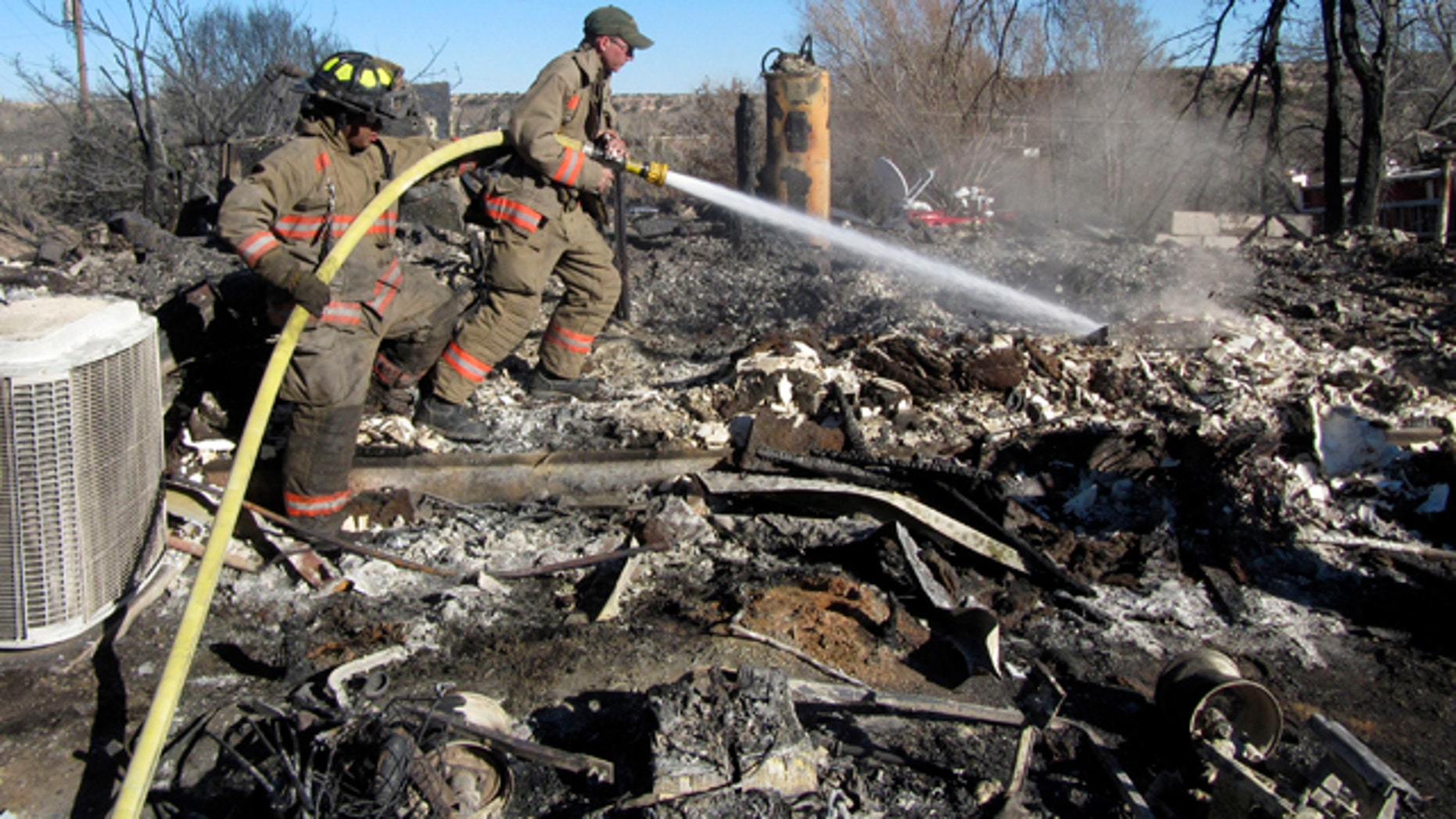 Feb. 28: Firefighters from Randall County work to douse hot spots at one of seven homes destroyed by wildfires in Lake Tanglewood, a small community of about 1,300 southeast of Amarillo, Texas.