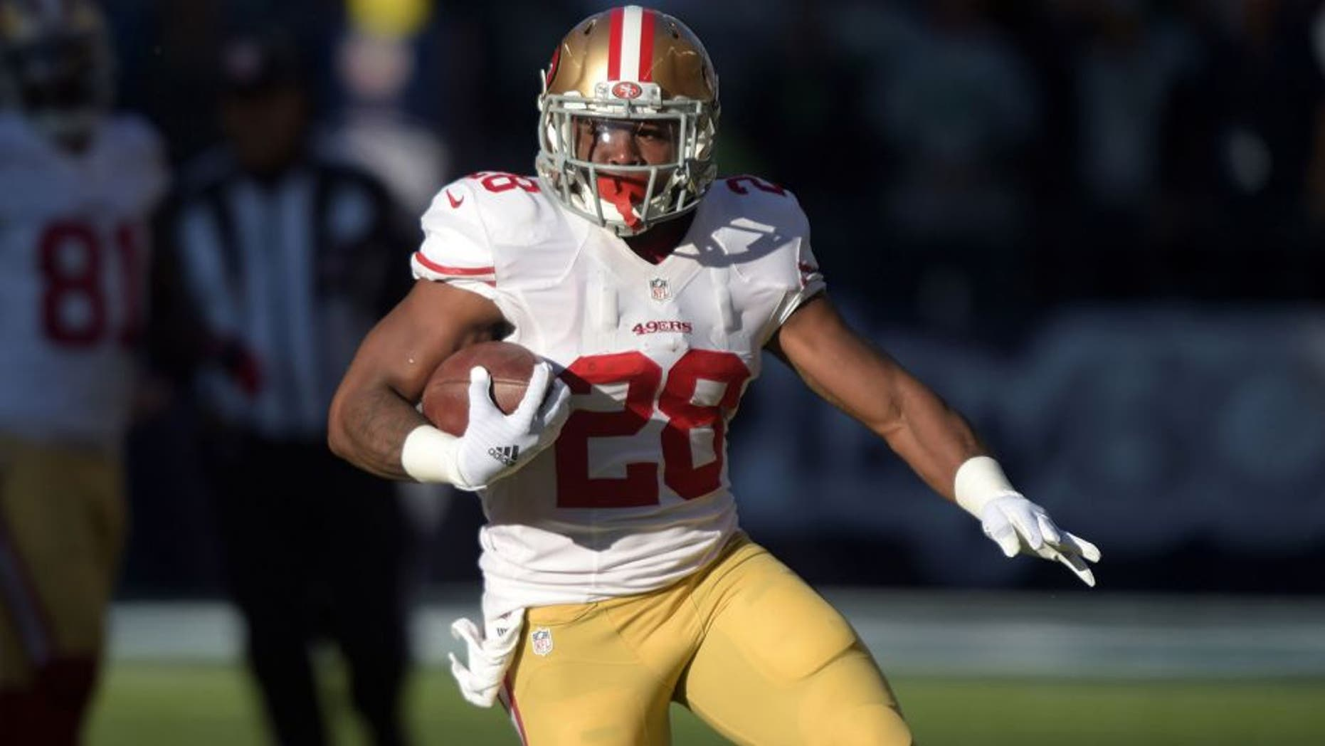 Dec 14, 2014; Seattle, WA, USA; San Francisco 49ers running back Carlos Hyde (28) carries the ball on a 289-yard run in the first quarter against the Seattle Seahawks at CenturyLink Field. Mandatory Credit: Kirby Lee-USA TODAY Sports