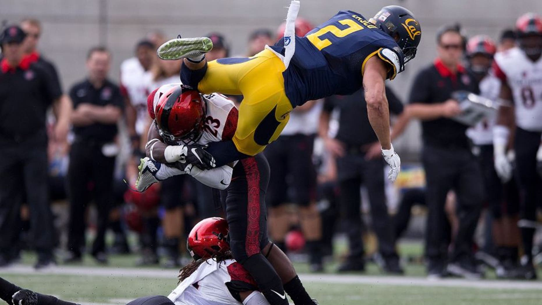 BERKELEY, CA - SEPTEMBER 12: Running back Daniel Lasco #2 of the California Golden Bears jumps past defensive back Na'im McGee #21 of the San Diego State Aztecs into defensive back Damontae Kazee #23 during the first quarter at California Memorial Stadium on September 12, 2015 in Berkeley, California. The California Golden Bears defeated the San Diego State Aztecs 35-7. (Photo by Jason O. Watson/Getty Images)