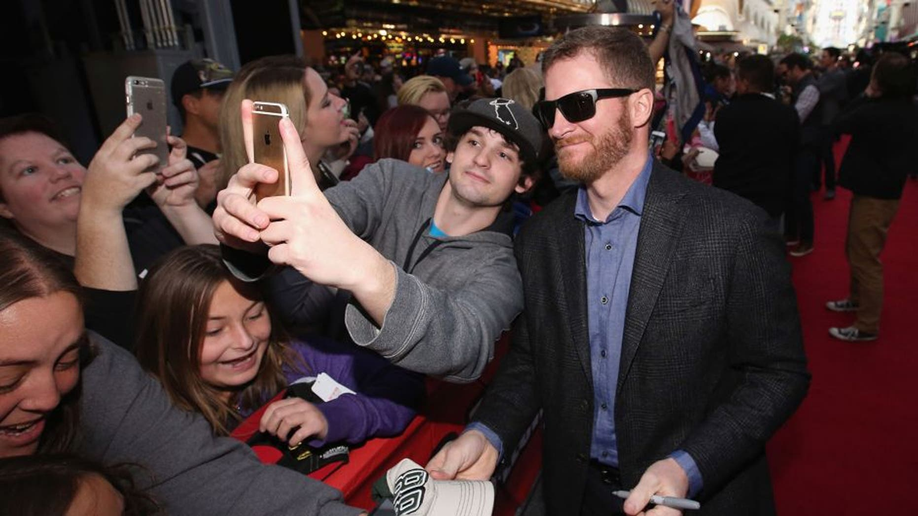 LAS VEGAS, NV - DECEMBER 02: NASCAR Sprint Cup Series driver Dale Earnhardt Jr. interacts with fans during the NASCAR Sprint Cup Series FanFest hosted by Las Vegas Motor Speedway on the Third Street Stage at the Fremont Street Experience on December 2, 2015 in Las Vegas, Nevada. (Photo by Sean Gardner/NASCAR via Getty Images)