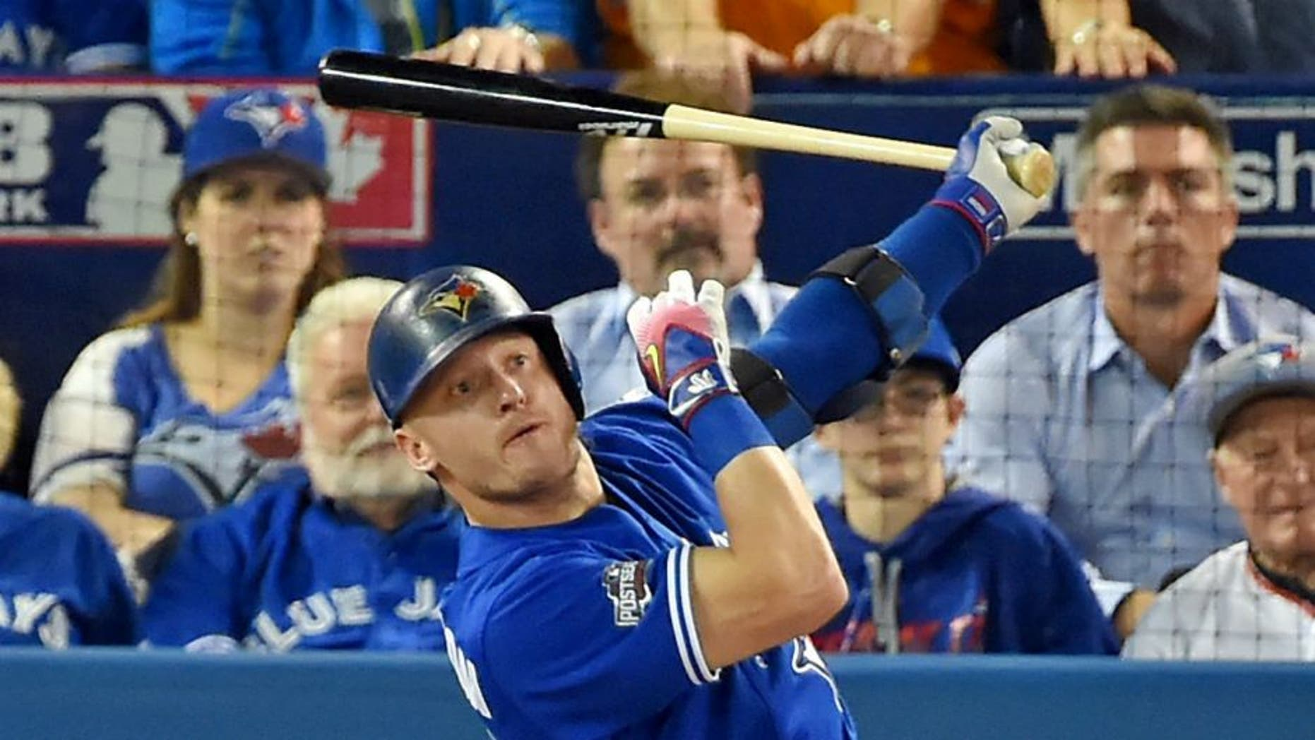 Oct 18, 2016; Toronto, Ontario, CAN; Toronto Blue Jays third baseman Josh Donaldson (20) hits a solo home run during the third inning against the Cleveland Indians in game four of the 2016 ALCS playoff baseball series at Rogers Centre. Mandatory Credit: Dan Hamilton-USA TODAY Sports