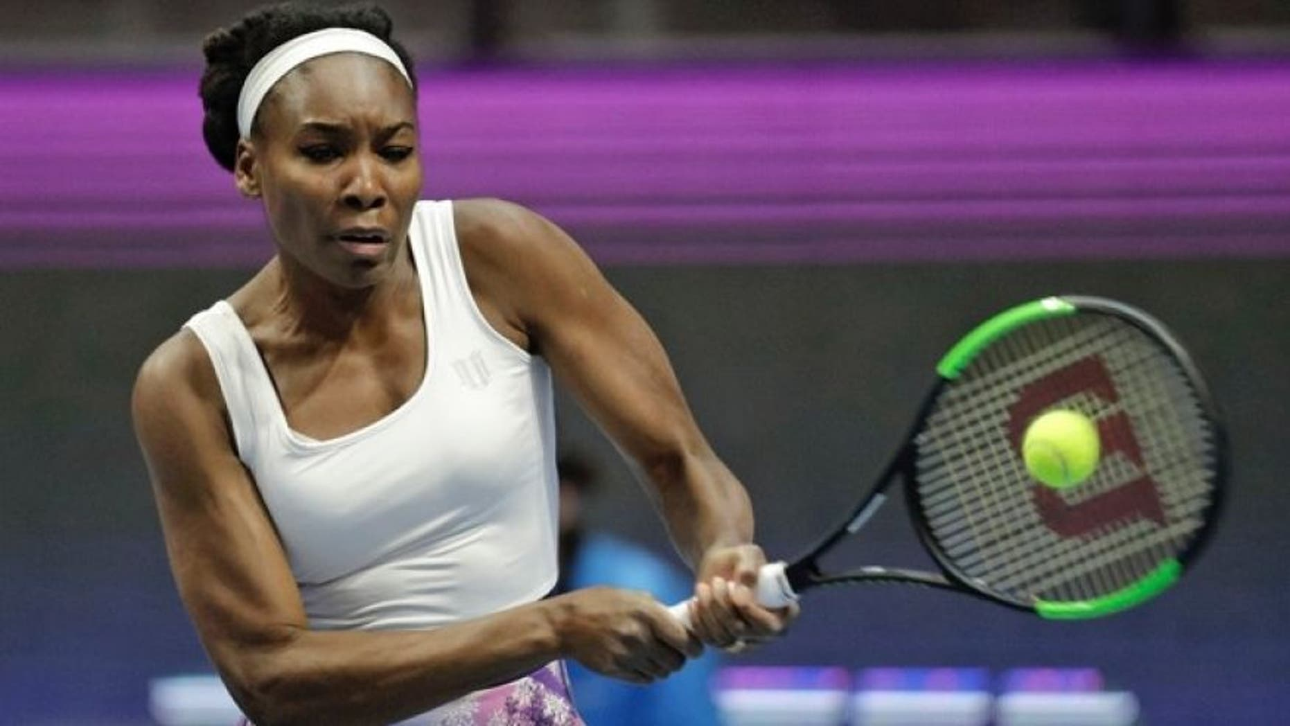 Venus Williams of the U.S. returns the ball to Kristina Mladenovic of France during the St. Petersburg Ladies Trophy-2017 tennis tournament match in St. Petersburg, Russia, Thursday, Feb. 2, 2017.