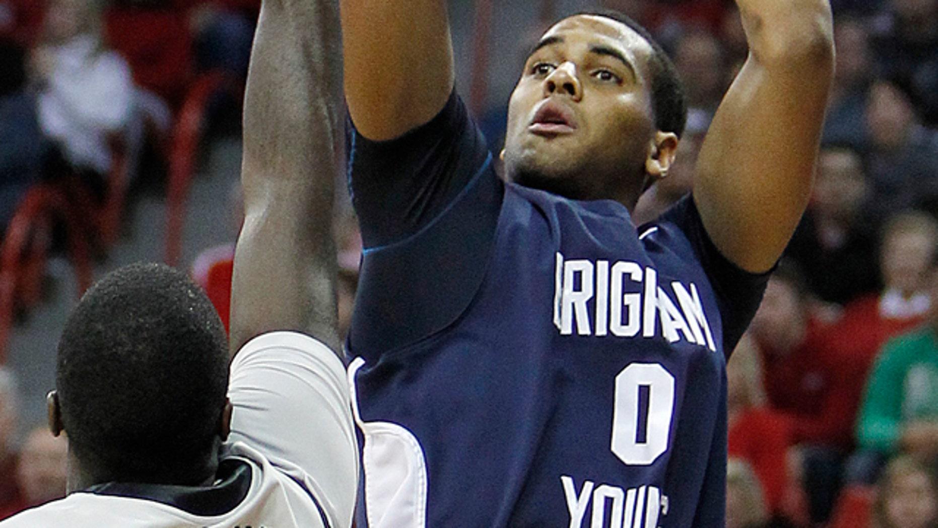 Jan. 5: BYU's Brandon Davies shoots over UNLV's Brice Massamba during an NCAA college basketball game in Las Vegas.