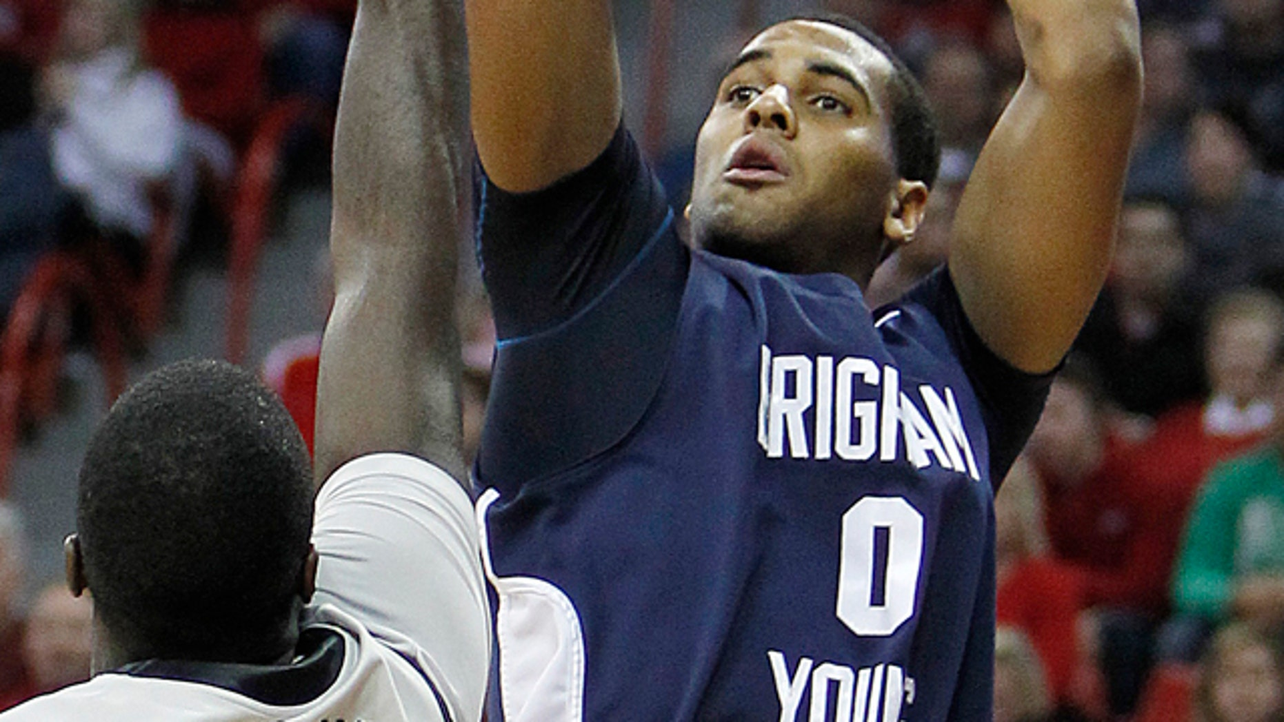 Jan. 5: BYU's Brandon Davies shoots over UNLV's Brice Massamba during an NCAA college basketball game in Las Vegas.