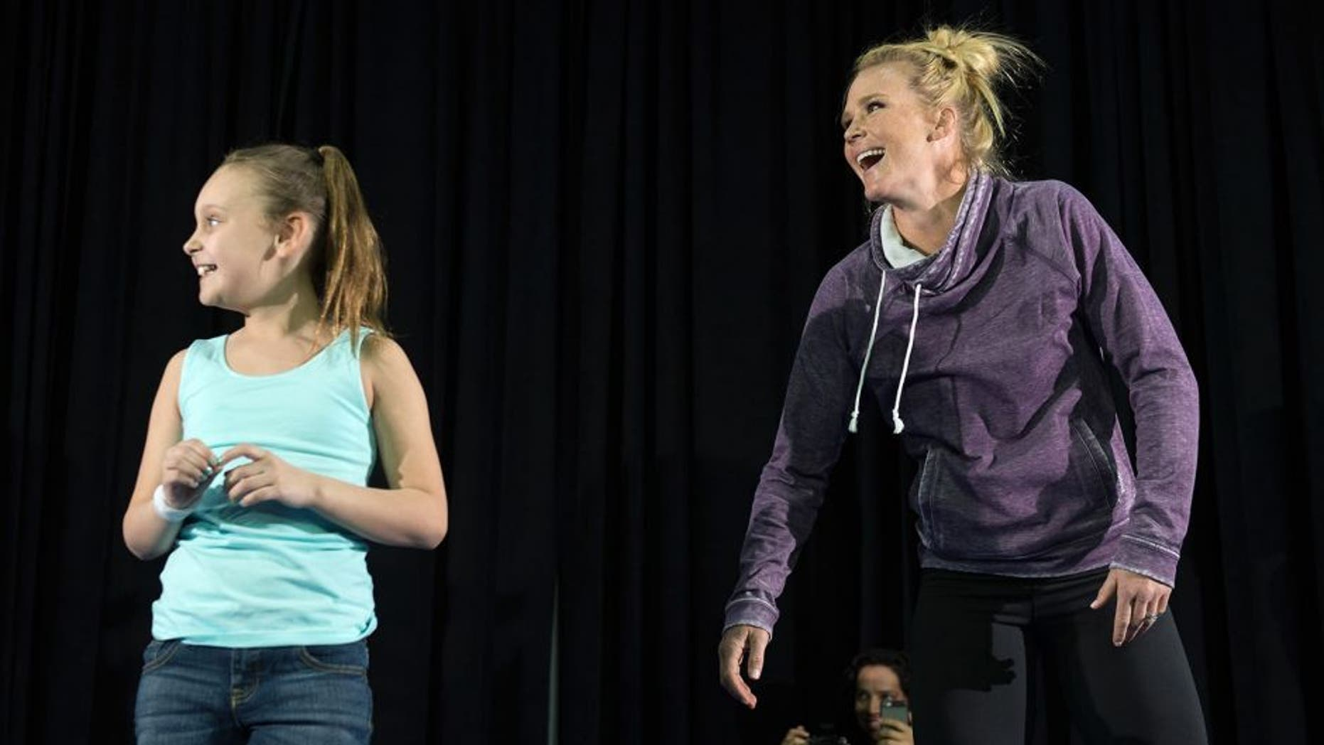LAS VEGAS, NV - MARCH 2: UFC bantamweight champion Holly Holm brings a fan on stage and holds an open training session for fans and media at the Jabbawockeez Theater in the MGM Grand Hotel/Casino on March 2, 2016 in Las Vegas, Nevada. (Photo by Brandon Magnus/Zuffa LLC/Zuffa LLC via Getty Images)