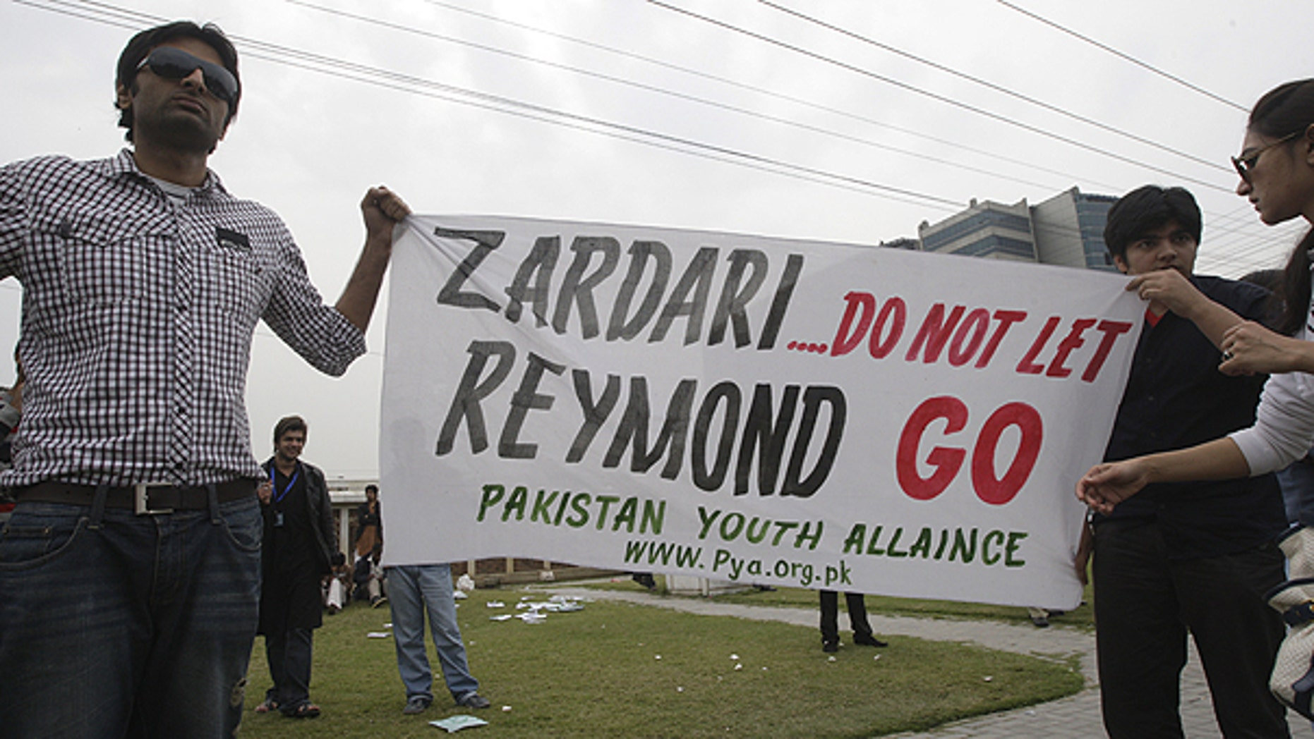 March 3: Pakistani students hold banner in Lahore, Pakistan against American CIA contractor Raymond Allen Davis.