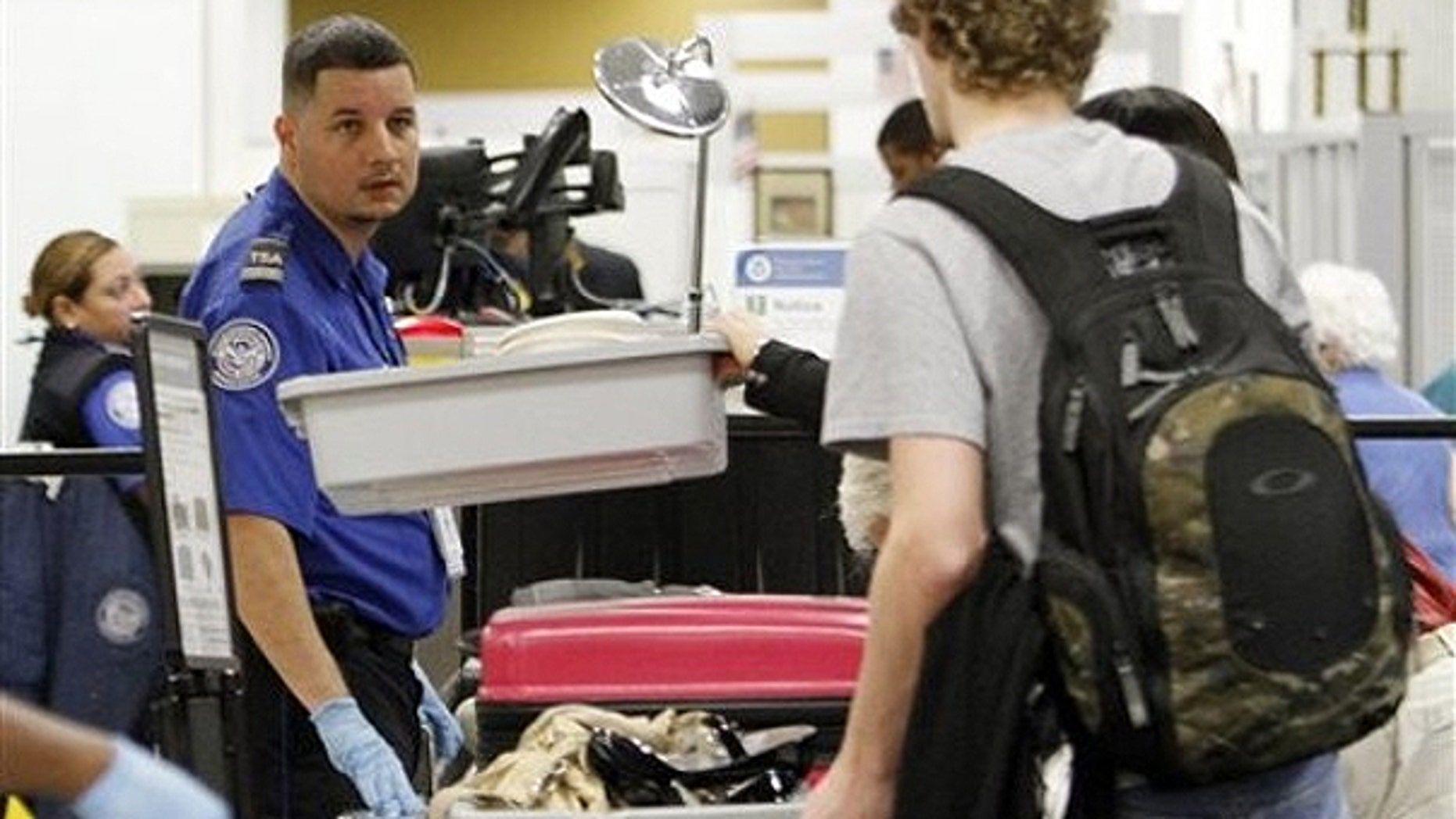 Dec. 23, 2010: A TSA officer checks passengers personal belongings at the X-ray machine at Miami International Airport in Miami.