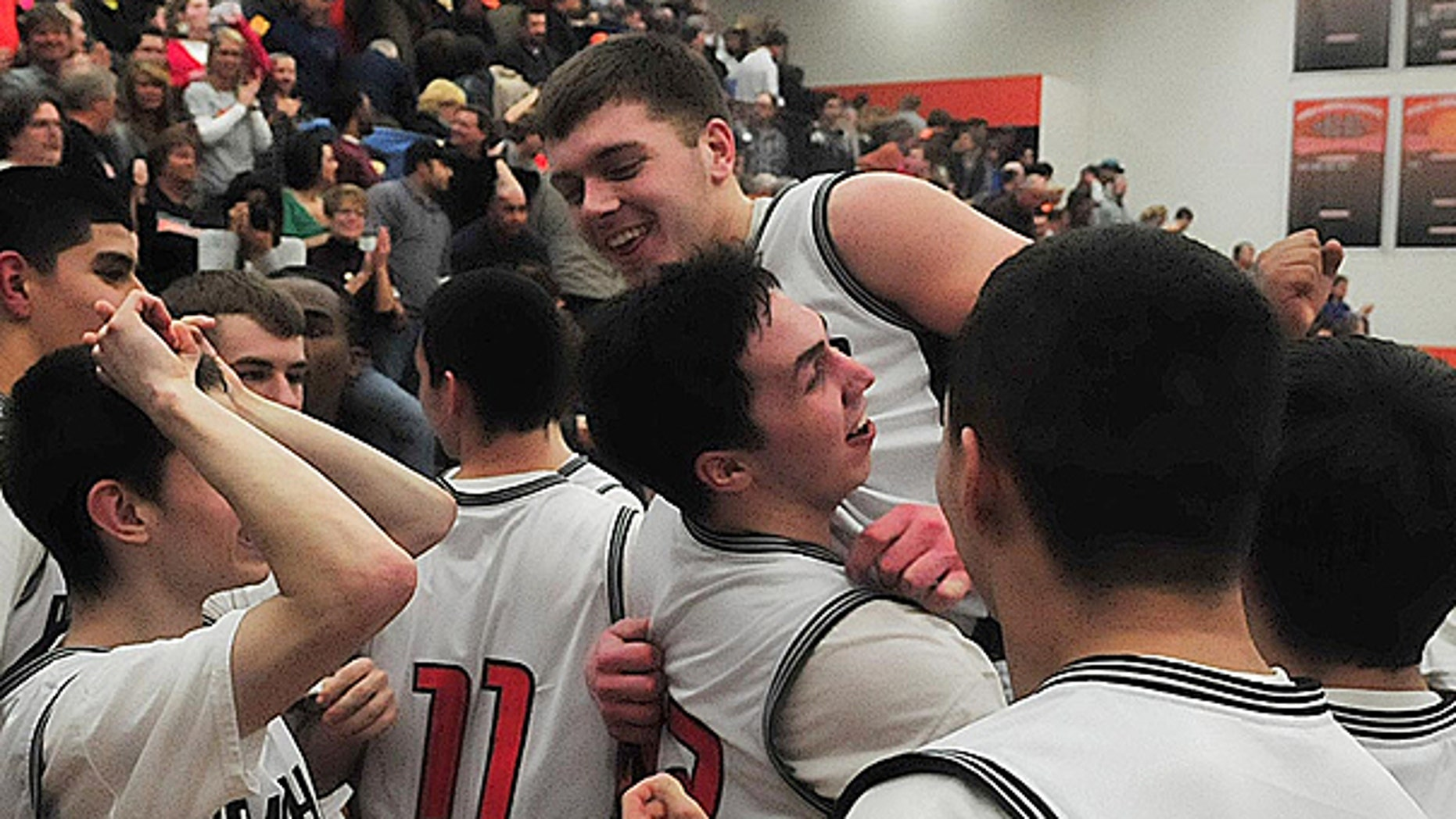 March 3: Teammates hoist Wes Leonard up after he hit the game-winning basket as the Fennville (Mich.) Blackhawks celebrate their victory against the Bridgman Bees, bringing their record to 20-0.