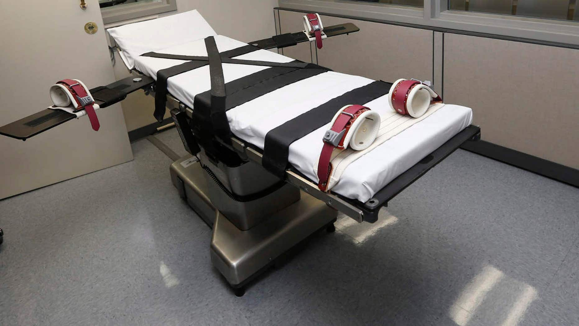 FILE - This Oct. 9, 2014, file photo shows the gurney in the the execution chamber at the Oklahoma State Penitentiary in McAlester, Okla.