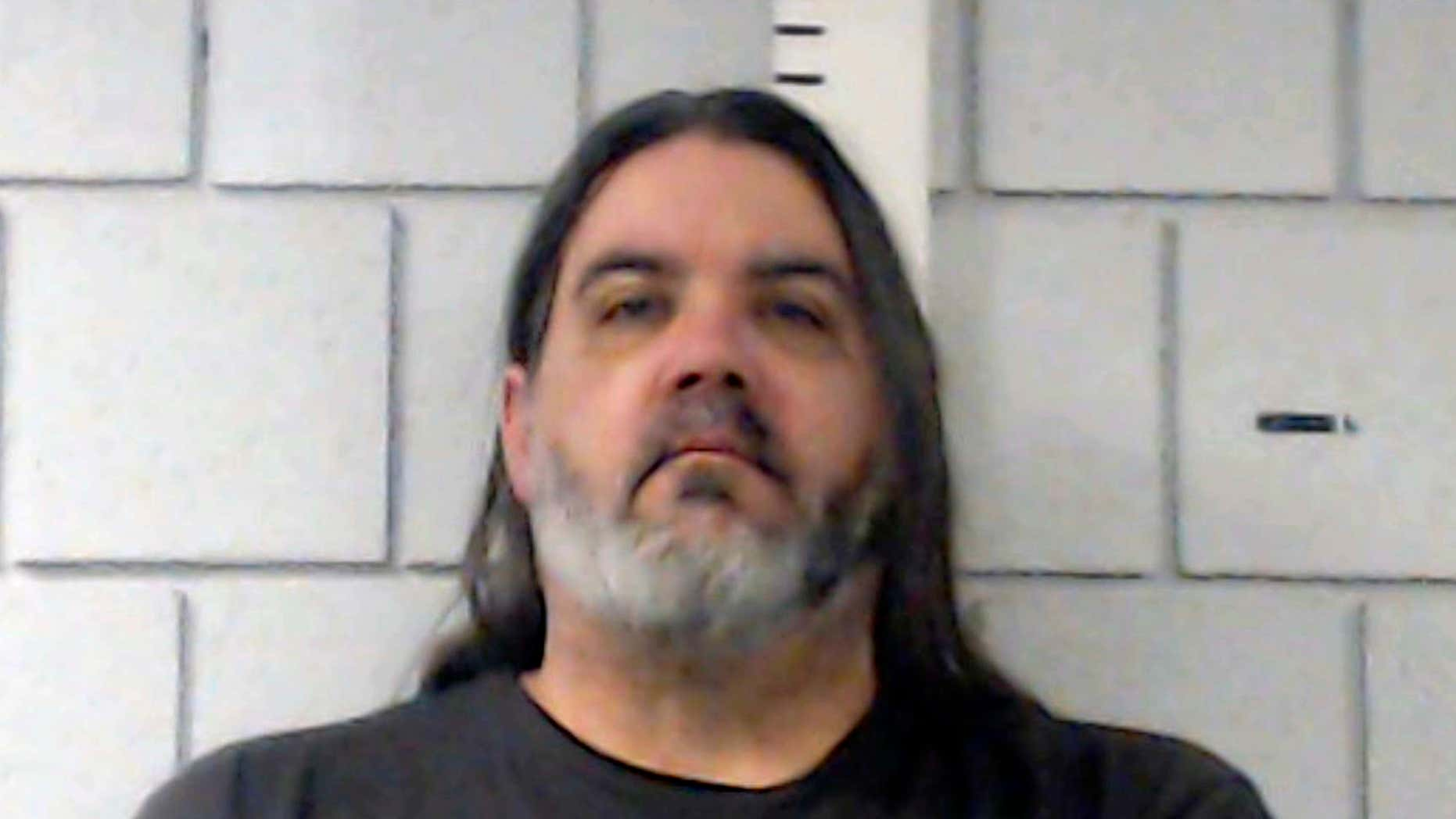 This undated photo provided by Monroe County Correctional Facility shows Christopher Barber.