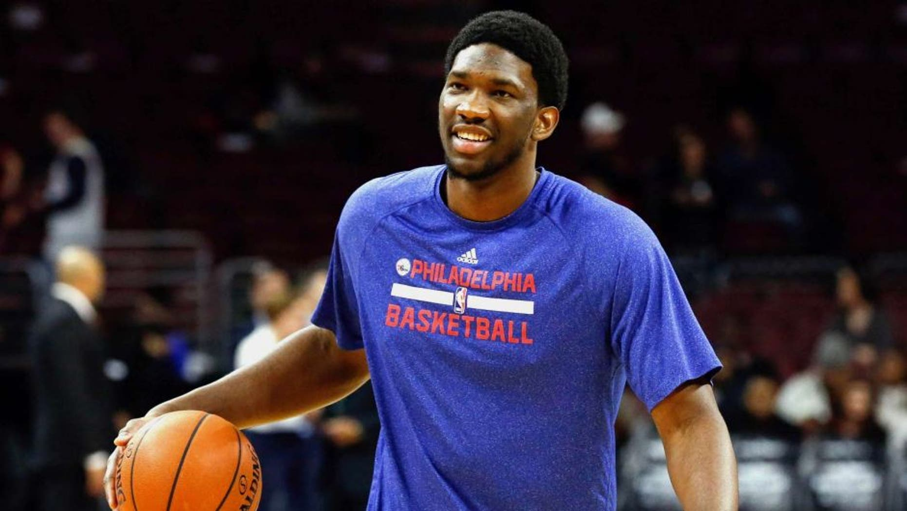 Jan 5, 2015; Philadelphia, PA, USA; Philadelphia 76ers injured center Joel Embiid (21) during warm ups before a game against the Cleveland Cavaliers at Wells Fargo Center. Mandatory Credit: Bill Streicher-USA TODAY Sports