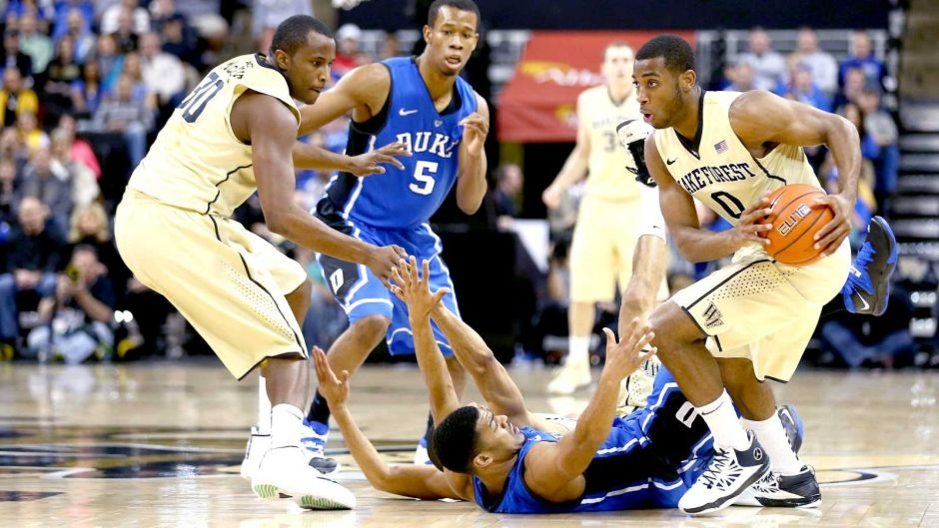 WINSTON-SALEM, NC - MARCH 05: Codi Miller-McIntyre #0 of the Wake Forest Demon Deacons steals the ball from Quinn Cook #2 of the Duke Blue Devils during their game against the Duke Blue Devils at Joel Coliseum on March 5, 2014 in Winston-Salem, North Carolina. (Photo by Streeter Lecka/Getty Images)