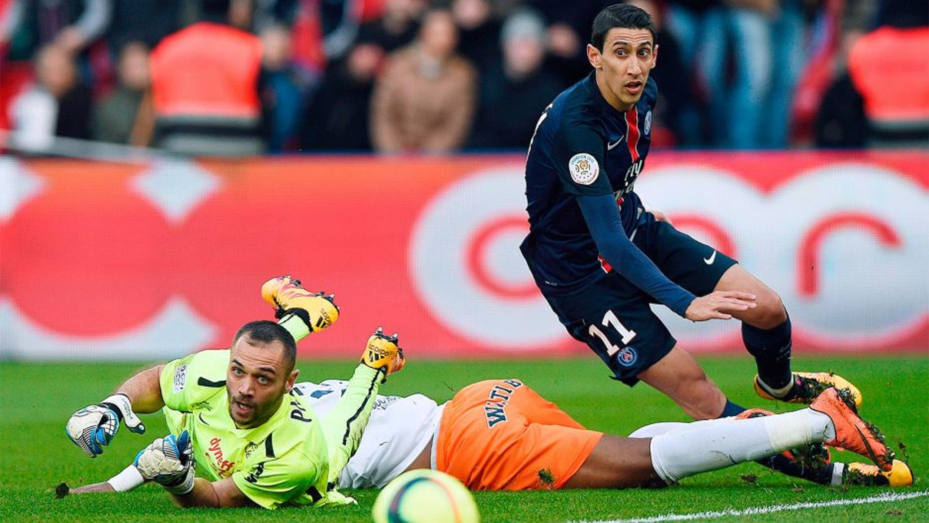 Montpellier's French goalkeeper Laurent Pionnier (L) falls next to Paris Saint-Germain's Argentinian forward Angel Di Maria (R) during the French L1 football match between Paris Saint-Germain (PSG) and Montpellier (MHSC) on March 5, 2016, at the Parc des Princes stadium in Paris. AFP PHOTO / FRANCK FIFE / AFP / FRANCK FIFE (Photo credit should read FRANCK FIFE/AFP/Getty Images)