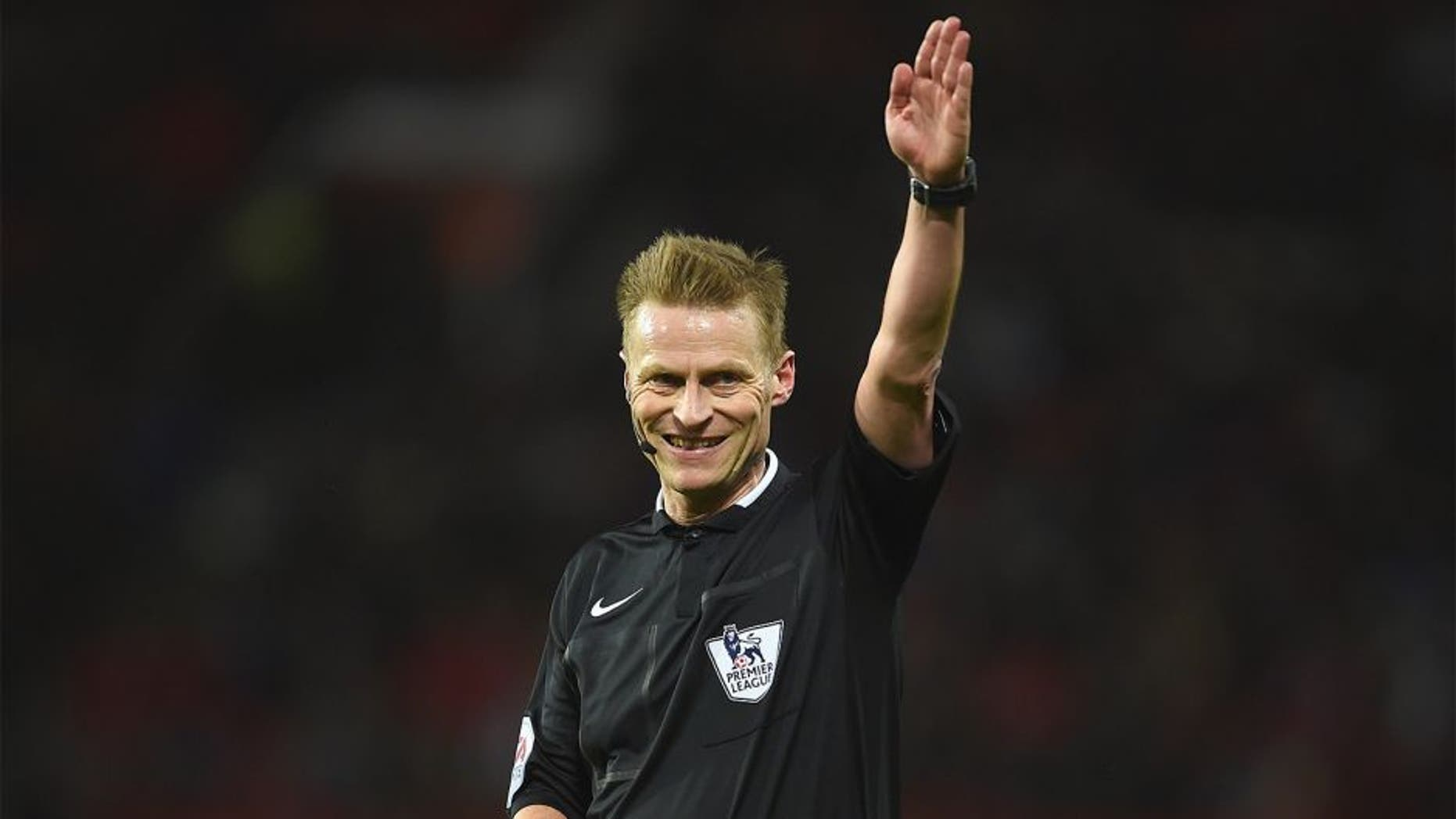 MANCHESTER, ENGLAND - MARCH 02: Referee Mike Jones gestures during the Barclays Premier League match between Manchester United and Watford at Old Trafford on March 2, 2016 in Manchester, England. (Photo by Laurence Griffiths/Getty Images)