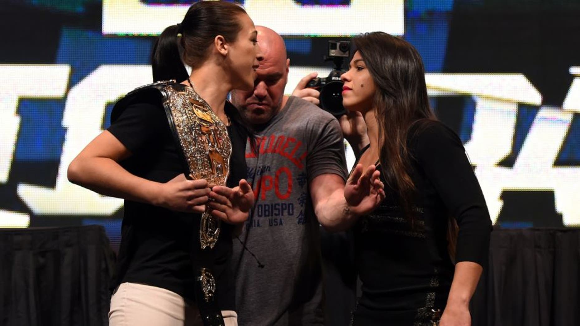 LAS VEGAS, NV - MARCH 04: (L-R) Opponents Joanna Jedrzejczyk and Claudia Gadelha face off during the UFC Unstoppable launch press conference at the MGM Grand Garden Arena on March 4, 2016 in Henderson, Nevada. (Photo by Josh Hedges/Zuffa LLC/Zuffa LLC via Getty Images)