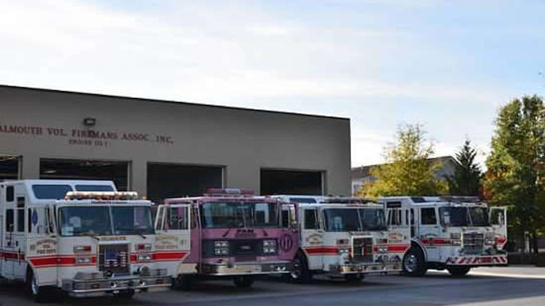 Falmouth Volunteer Fire Department fire engines on display.