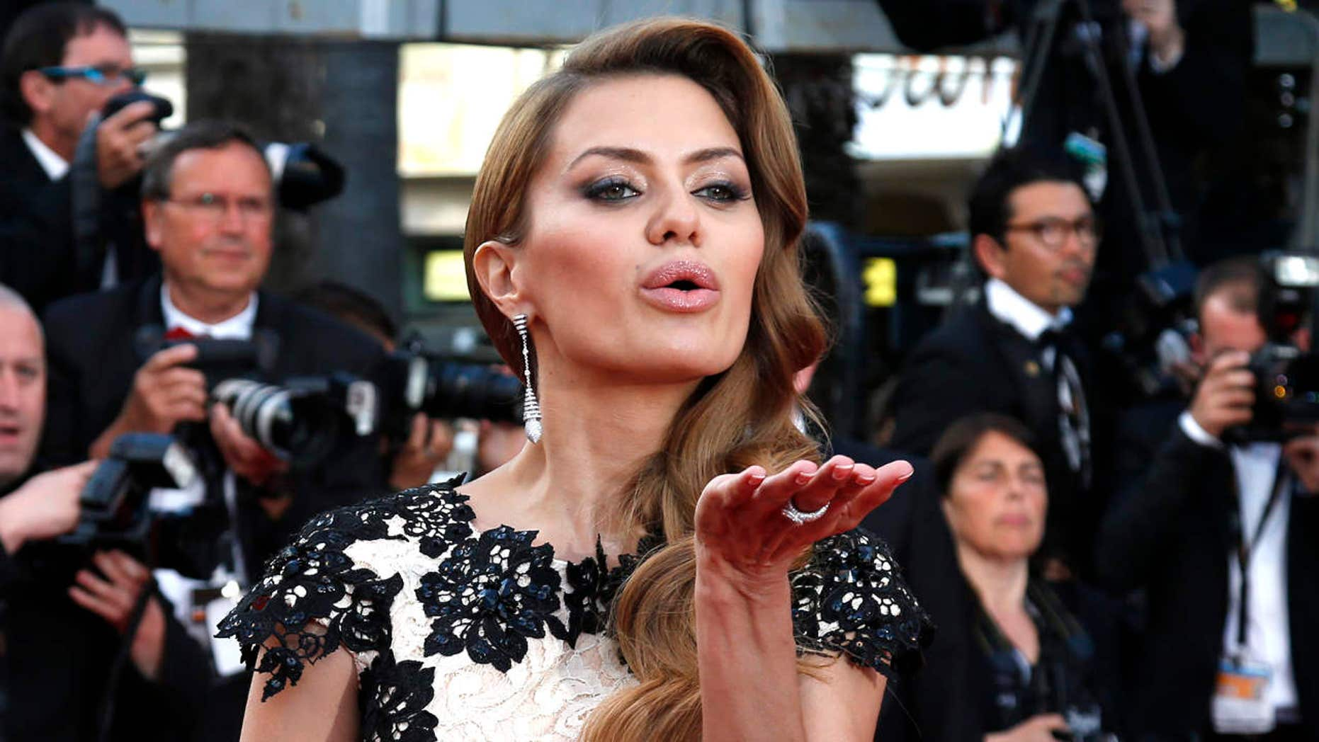 "May 16, 2014: Russian television host Victoria Bonya blows a kiss as she poses on the red carpet for the screening of the film ""How to Train Your Dragon 2"" out of competition at the 67th Cannes Film Festival in Cannes."