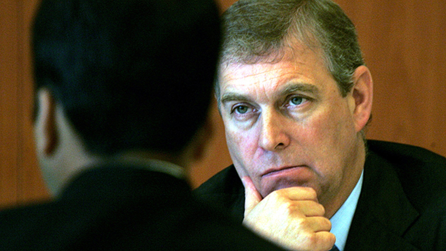 In this Monday, Oct. 30, 2006 file photo Prince Andrew, The Duke of York and U.K. Special Representative for International Trade and Investment, gestures during a luncheon session in his honor, organized by Indian Chambers of Commerce and Industries in New Delhi, India.