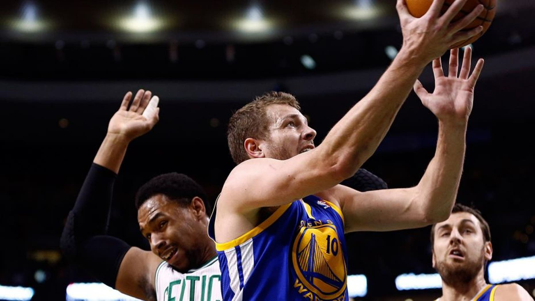 Mar 5, 2014; Boston, MA, USA; Golden State Warriors power forward David Lee (10) shoots the ball against Boston Celtics center Jared Sullinger (7) during the first half at TD Garden. Mandatory Credit: Mark L. Baer-USA TODAY Sports