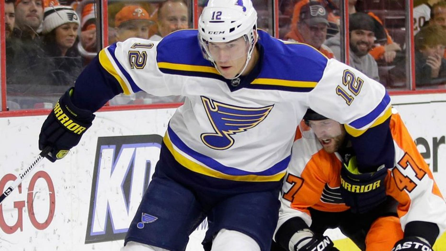 St. Louis Blues' Jori Lehtera (12), of Finland, keeps Philadelphia Flyers' Andrew MacDonald (47) away from the puck during the first period of an NHL hockey game, Thursday, March 5, 2015, in Philadelphia. (AP Photo/Matt Slocum)