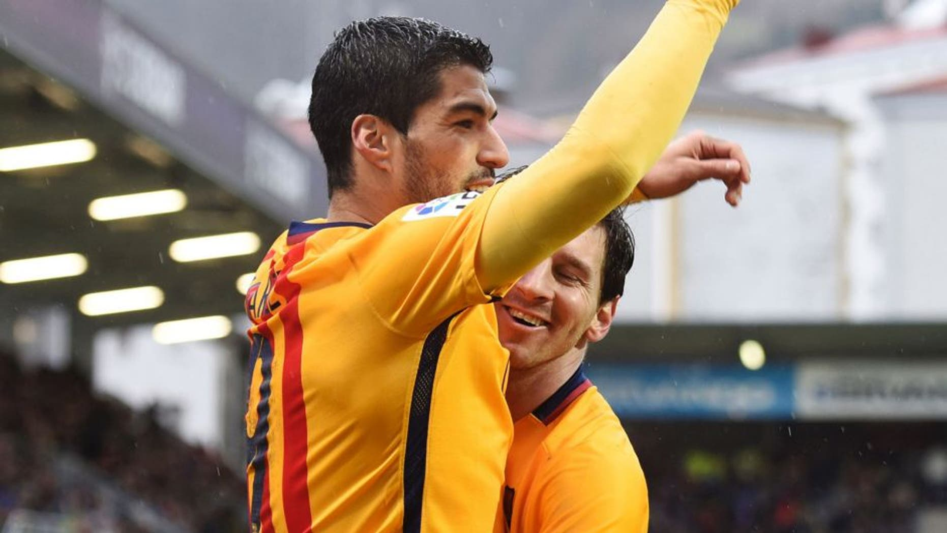 Barcelona's Uruguayan forward Luis Suarez (L) is congratulated by Argentinian forward Lionel Messi after scoring during the Spanish league football match SD Eibar vs FC Barcelona at the Ipurua stadium in Eibar on March 6, 2016. / AFP / ANDER GILLENEA (Photo credit should read ANDER GILLENEA/AFP/Getty Images)