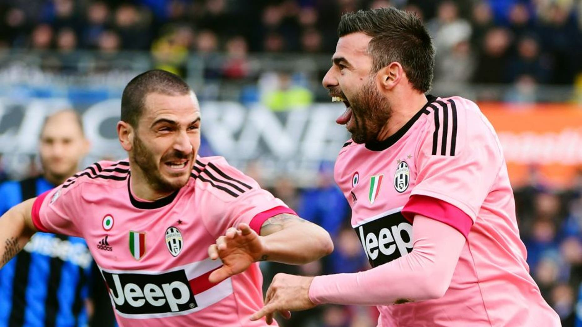 Juventus' Italian defender Andrea Barzagli (R) celebrates with Juventus' Italian defender Leonardo Bonucci after scoring a goal during the Italian Serie A football match between Atalanta and Juventus on March 6, 2016 at the Azzuri Stadium in Bergamo. / AFP / OLIVIER MORIN (Photo credit should read OLIVIER MORIN/AFP/Getty Images)