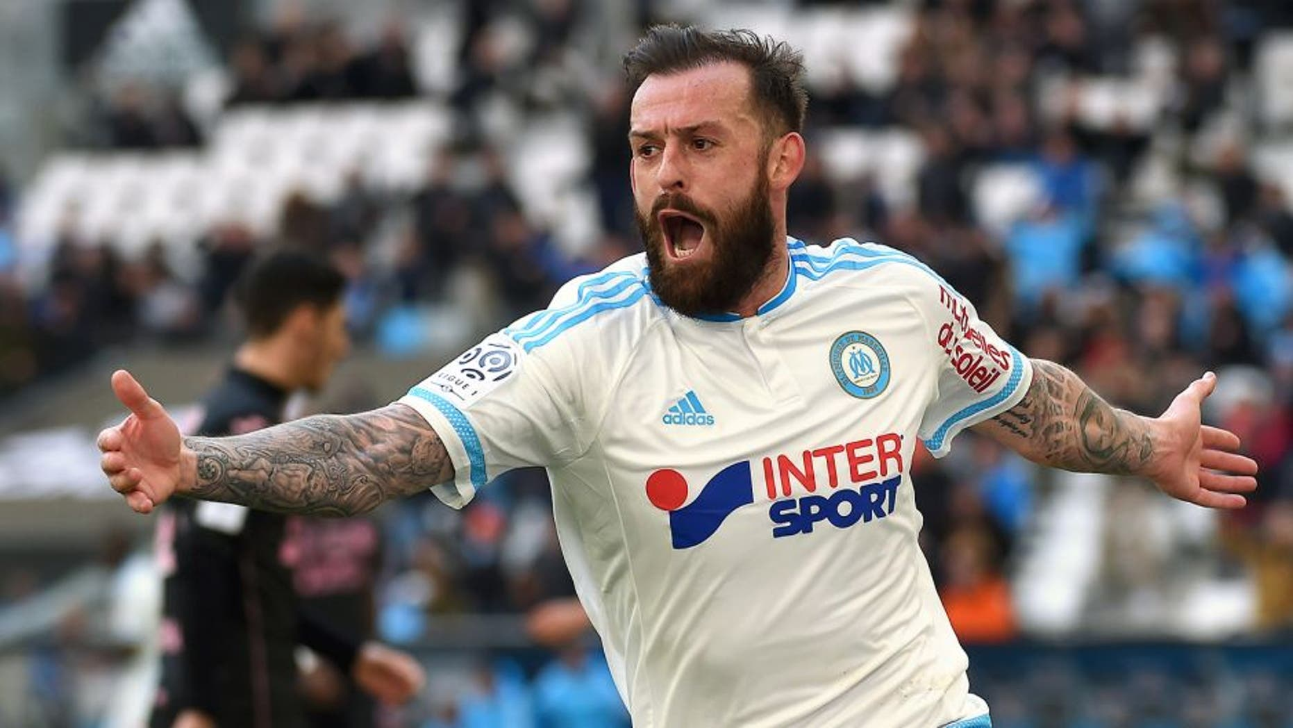 Marseille's Scottish forward Steven Fletcher celebrates after scoring a goal during the French L1 football match between Marseille and Toulouse on March 6, 2016 at the Velodrome stadium in Marseille, southern France. AFP PHOTO / ANNE-CHRISTINE POUJOULAT / AFP / ANNE-CHRISTINE POUJOULAT (Photo credit should read ANNE-CHRISTINE POUJOULAT/AFP/Getty Images)