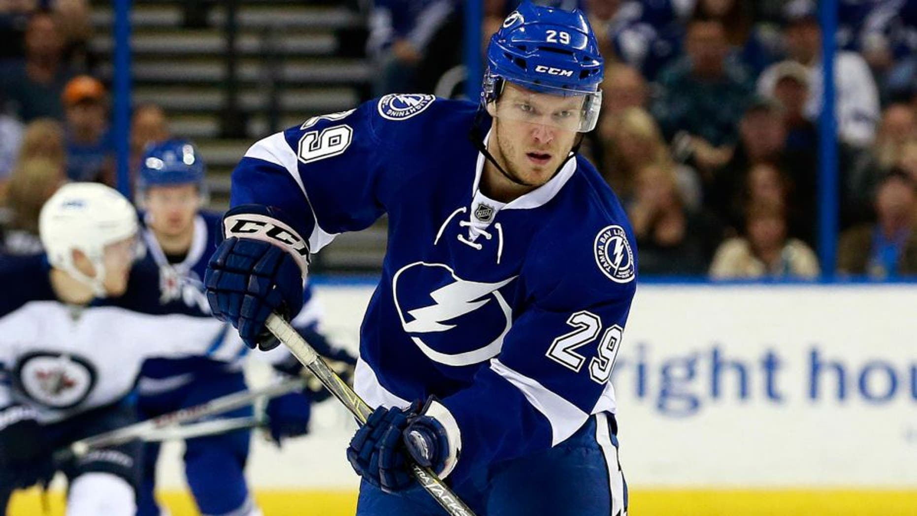 Feb 18, 2016; Tampa, FL, USA; Tampa Bay Lightning defenseman Slater Koekkoek (29) passes the puck against the Winnipeg Jets during the second period at Amalie Arena. Mandatory Credit: Kim Klement-USA TODAY Sports