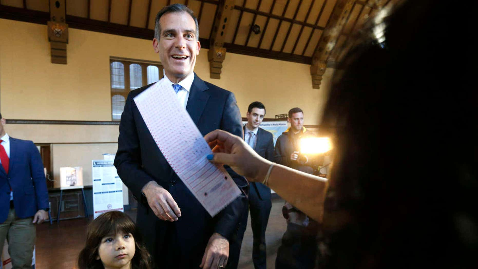 Los Angeles Mayor Eric Garcetti casts his election ballot with his daughter Maya in Los Angeles, on Tuesday, March 7, 2017.