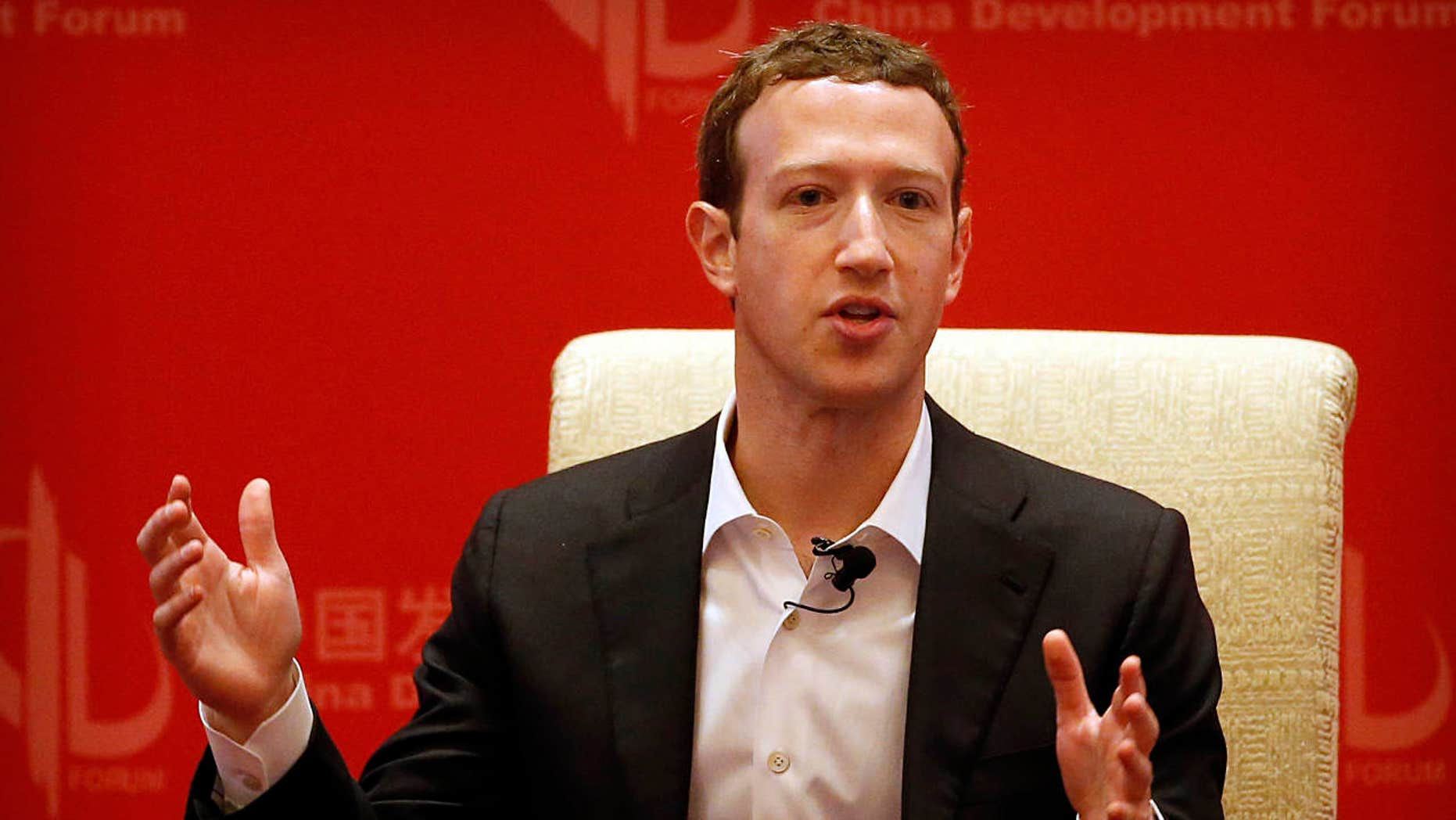 FILE - In this Saturday, March 19, 2016, file photo, Facebook CEO Mark Zuckerberg speaks during a panel discussion held as part of the China Development Forum at the Diaoyutai State Guesthouse in Beijing.