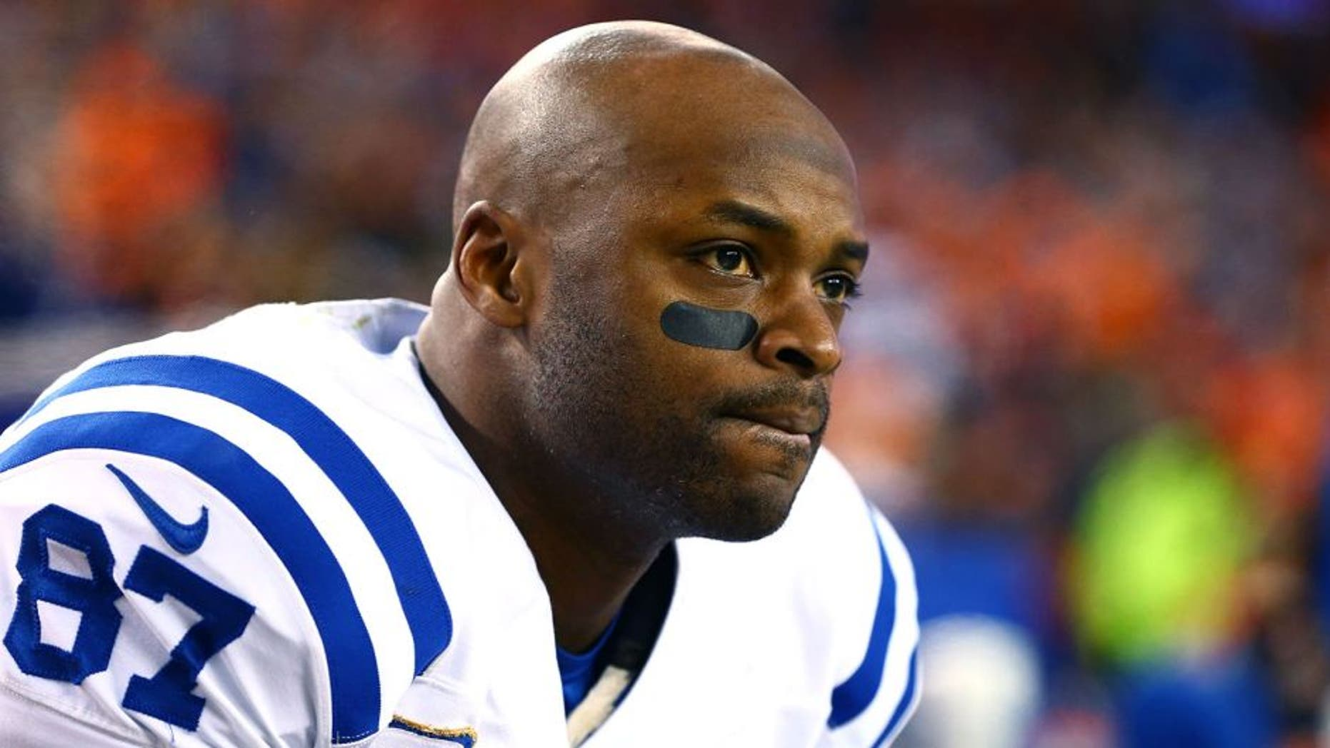 Jan 11, 2015; Denver, CO, USA; Indianapolis Colts wide receiver Reggie Wayne on the sidelines in the fourth quarter against the Denver Broncos in the 2014 AFC Divisional playoff football game at Sports Authority Field at Mile High. The Colts defeated the Broncos 24-13. Mandatory Credit: Mark J. Rebilas-USA TODAY Sports