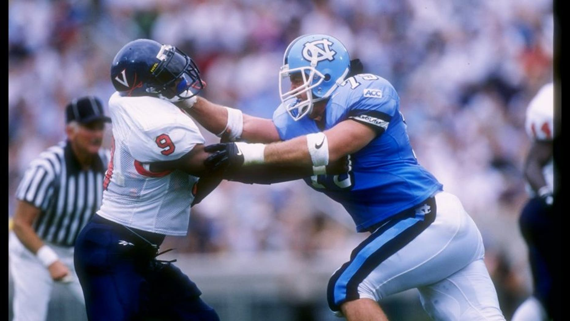 27 Sep 1997: Ryan Hoffman (right) of North Carolina battles Shannon Taylor #9 of the Virginia Cavaliers during the Tar Heels 48-20 win at Kenan Stadium in Chapel Hill, North Carolina. Mandatory Credit: Doug Pensinger /Allsport