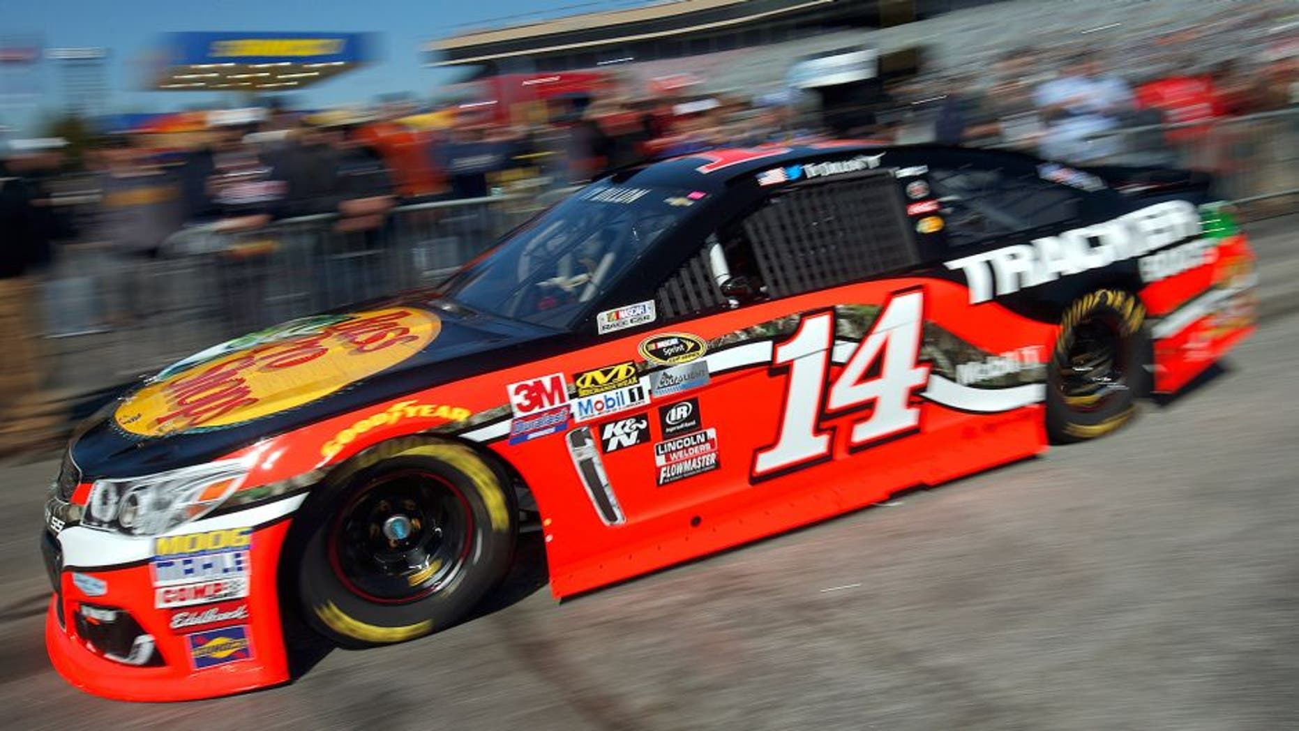 HAMPTON, GA - FEBRUARY 27: Ty Dillon drives the #14 Bass Pro Shops/Tracker Boats Chevrolet through the garage area during practice for the NASCAR Sprint Cup Series Folds of Honor QuikTrip 500 at Atlanta Motor Speedway on February 27, 2016 in Hampton, Georgia. (Photo by Todd Warshaw/NASCAR via Getty Images)
