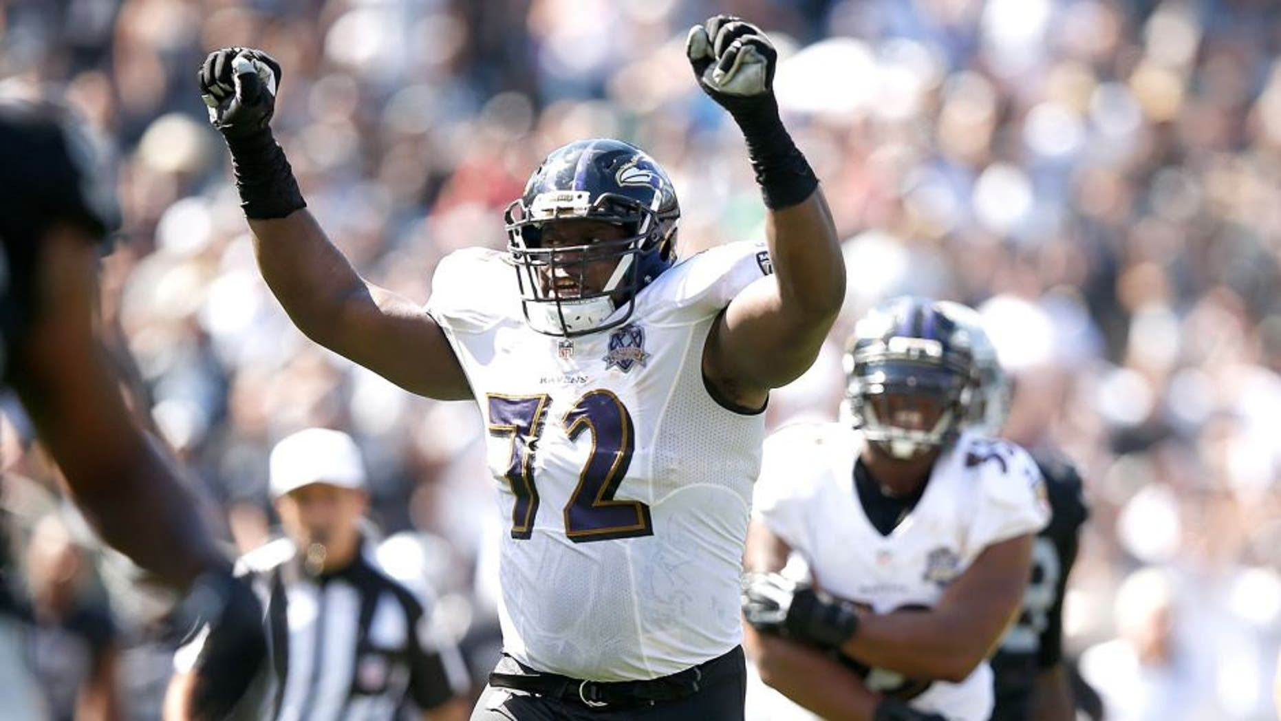 OAKLAND, CA - SEPTEMBER 20: Kelechi Osemele #72 of the Baltimore Ravens celebrates a touchdown in the second quarter against the Oakland Raiders at Oakland-Alameda County Coliseum on September 20, 2015 in Oakland, California. (Photo by Ezra Shaw/Getty Images)