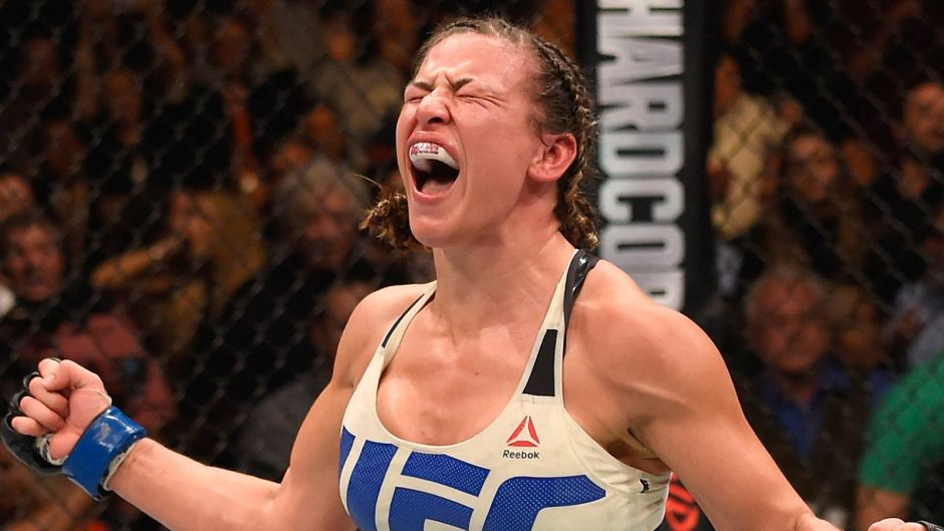 LAS VEGAS, NV - MARCH 05: Miesha Tate reacts after her submission victory over Holly Holm in their UFC women's bantamweight championship bout during the UFC 196 event inside MGM Grand Garden Arena on March 5, 2016 in Las Vegas, Nevada. (Photo by Josh Hedges/Zuffa LLC/Zuffa LLC via Getty Images)