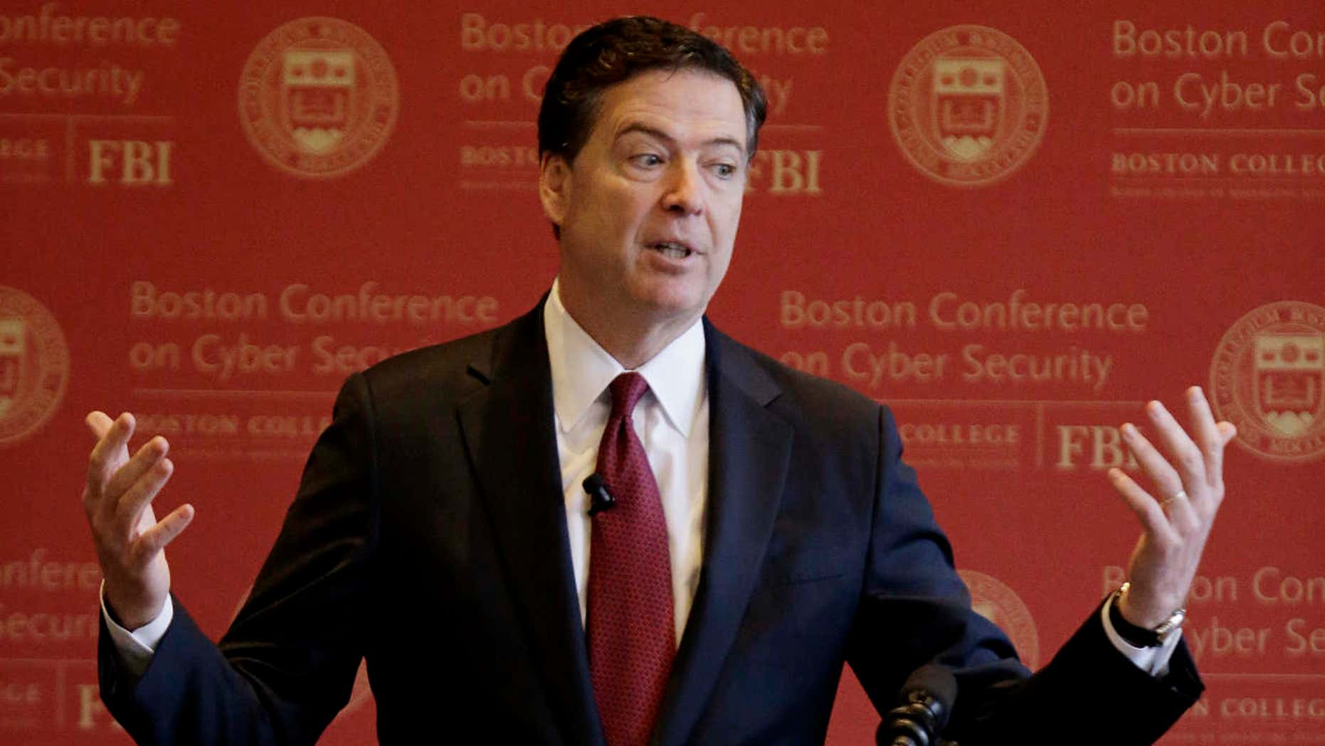 FBI Director James Comey gestures as he speaks on cyber security at the first Boston Conference of Cyber Security at Boston College, Wednesday, March 8, 2017, in Boston.