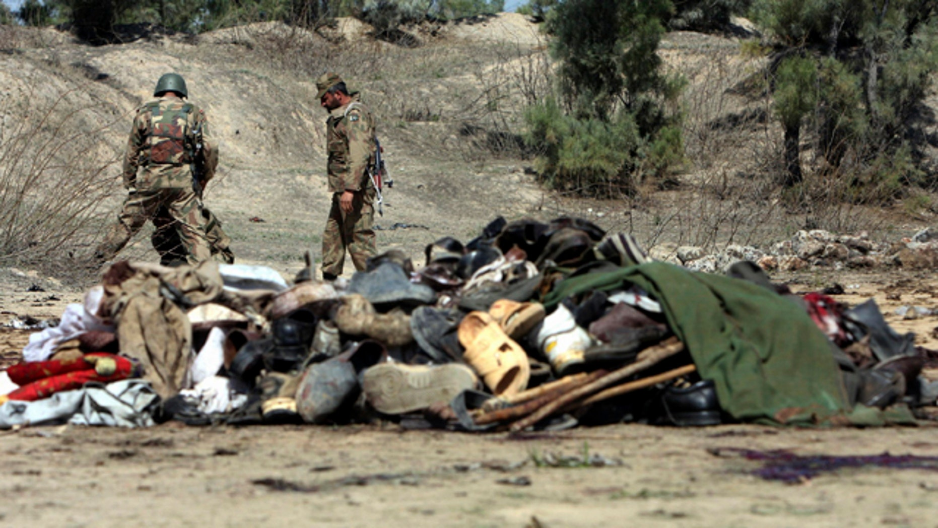 March 9: Pakistani army soldiers look for evidence at the site of bomb blast in Matani near Peshawar, Pakistan.