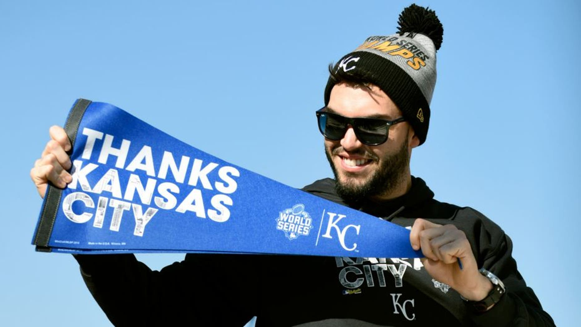 KANSAS CITY, MO -NOVERMBER 3: Eric Hosmer #35 of the Kansas City Royals holds up a pennant thanking fans during a parade to celebrate their World Series victory on November 3, 2015 in Kansas City, Missouri. (Photo by Ed Zurga/Getty Images)