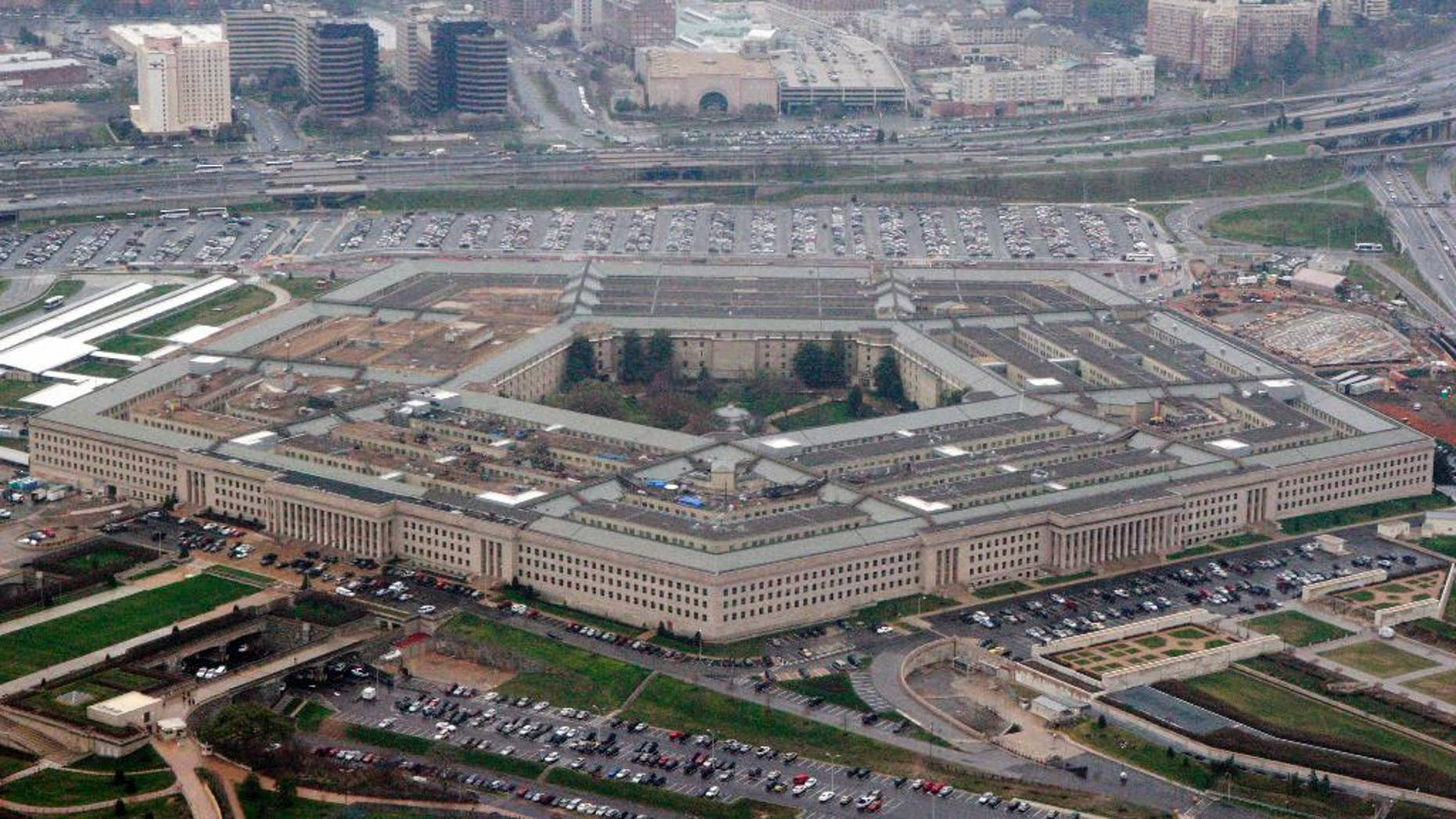 "FILE - The Pentagon is seen in this aerial view in Washington, in this March 27, 2008 file photo. The Pentagon has revised its Law of War guidelines to remove wording that could permit U.S. military commanders to treat war correspondents as ""unprivileged belligerents"" if they think the journalists are sympathizing or cooperating with enemy forces. The amended manual, published on July 22, 2016, also drops wording that equated journalism with spying. (AP Photo/Charles Dharapak, File)"