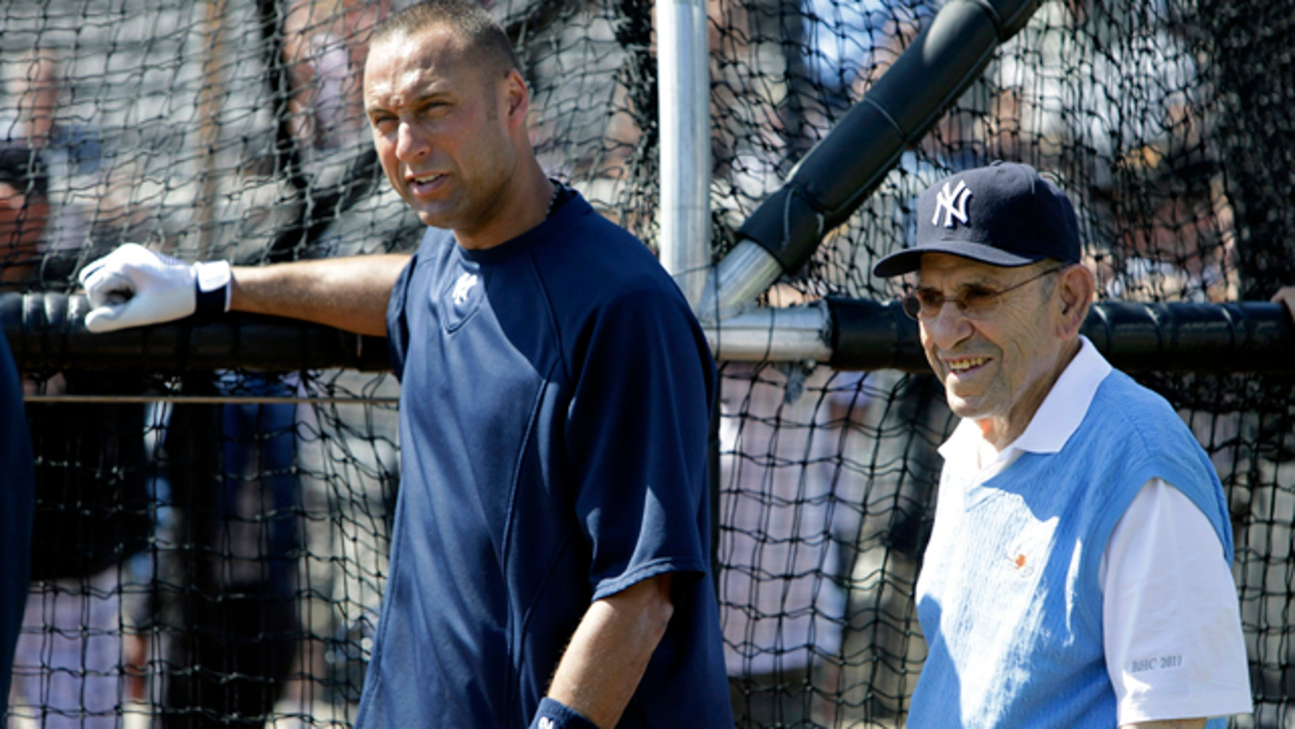 Feb. 23: New York Yankees Hall of Fame catcher Yogi Berra, right, talks with Yankees shortstop Derek Jeter, left, during a baseball spring training workout at Steinbrenner Field in Tampa, Fla.