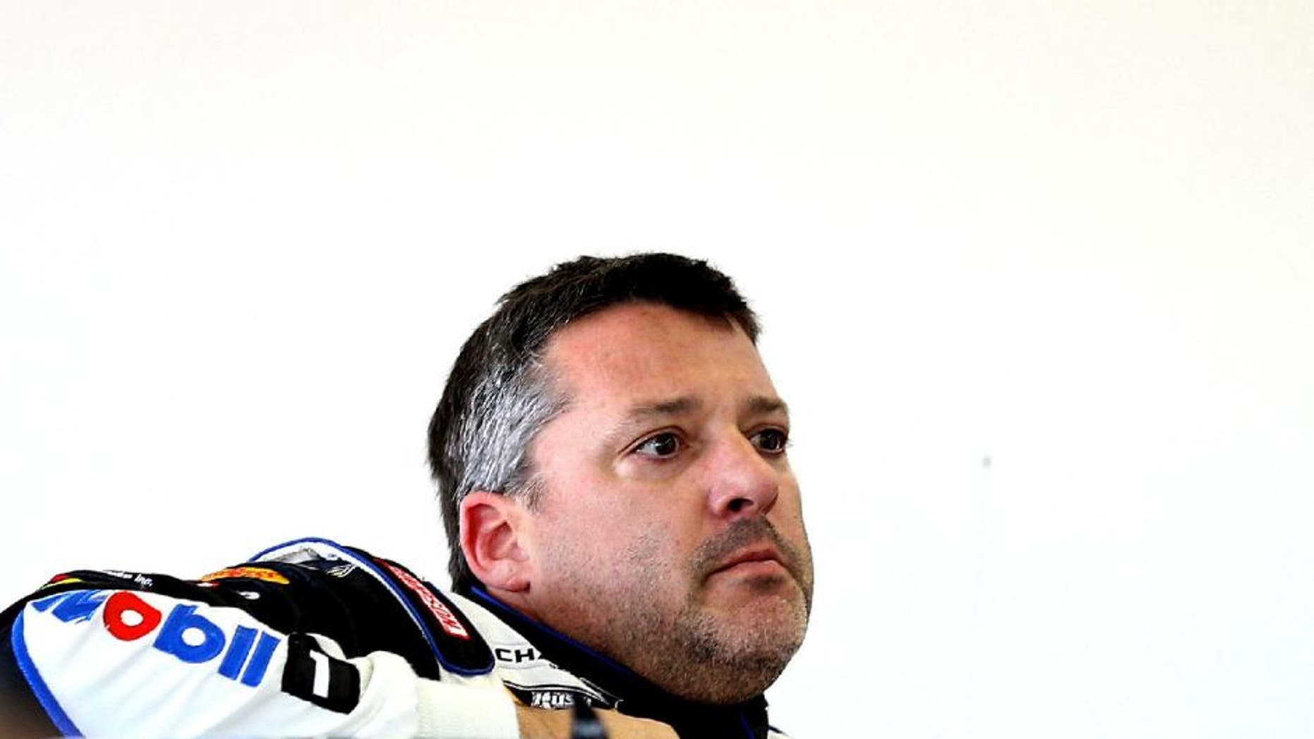 LAS VEGAS, NV - MARCH 06: Tony Stewart, driver of the #14 Mobil 1/Bass Pro Shops Chevrolet, stands in the garage during practice for the NASCAR Sprint Cup Series Kobalt 400 at Las Vegas Motor Speedway on March 6, 2015 in Las Vegas, Nevada. (Photo by Patrick Smith/NASCAR via Getty Images)