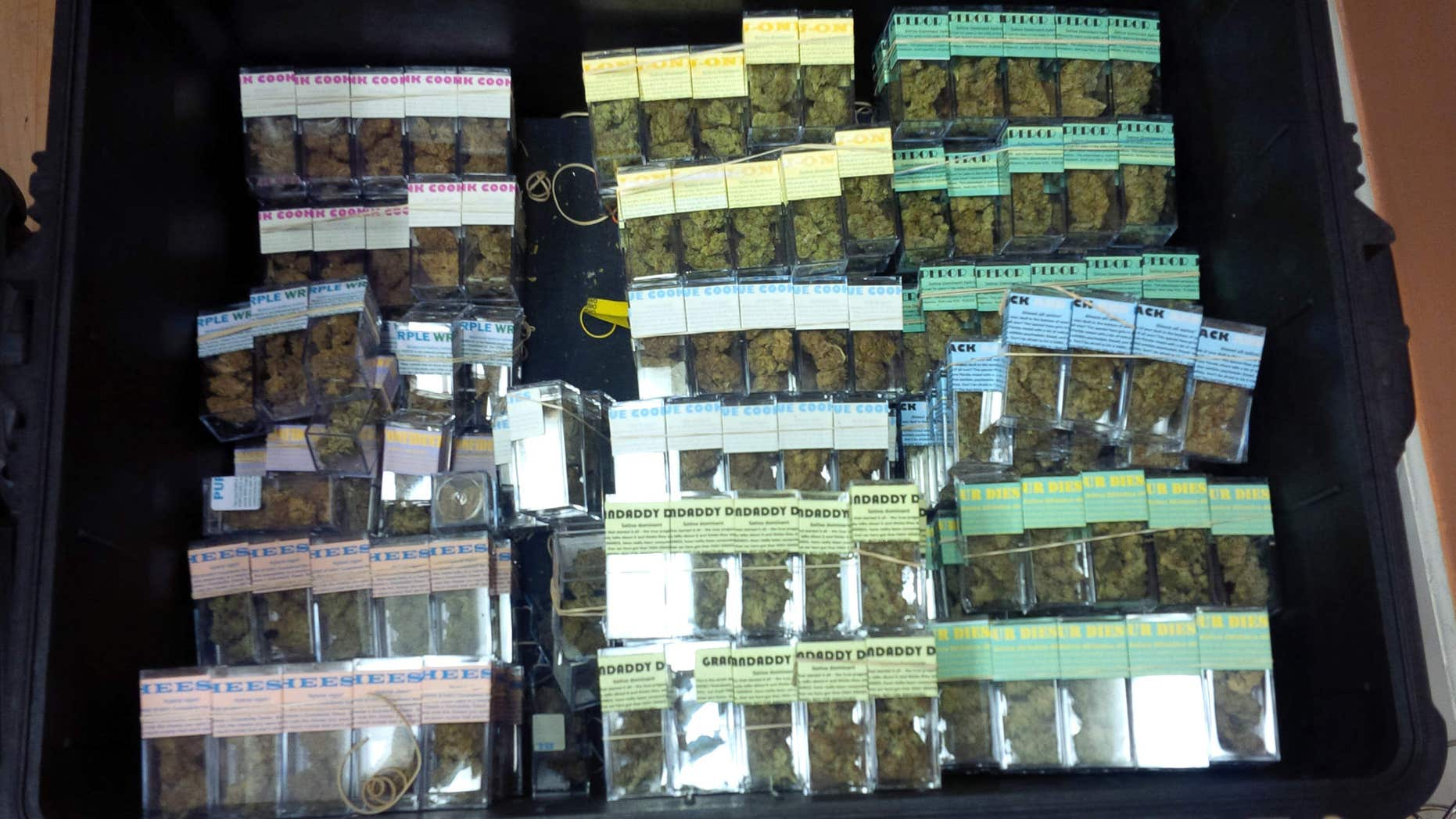 In this undated photo provided by the New York City Police Department, containers of packaged marijuana ready to be sold are shown inside a New York warehouse.