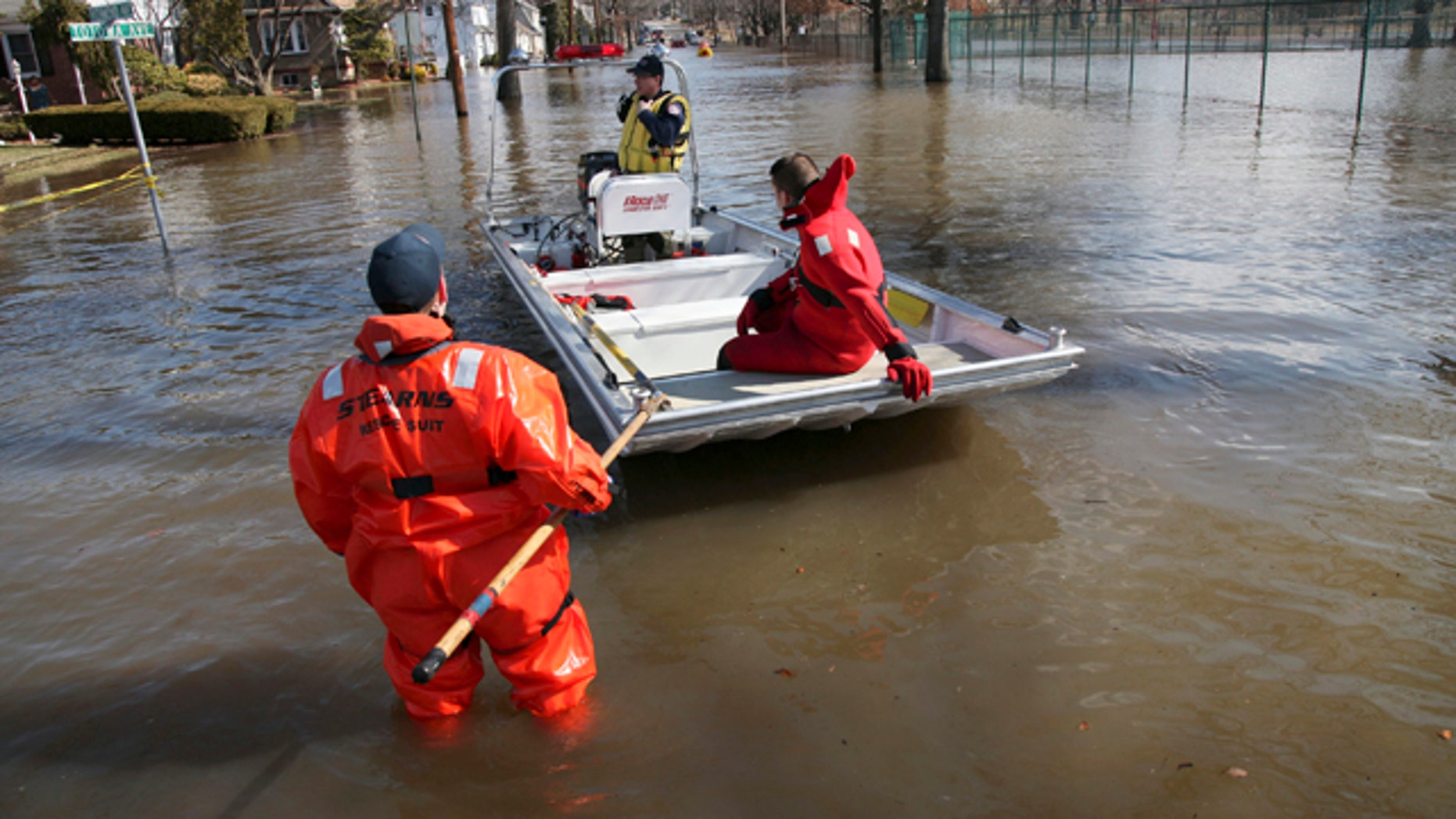 March 12: Paterson, N.J., firefighters make their way onto Totowa Avenue to evacuate residents that need assistance in Paterson, N.J.