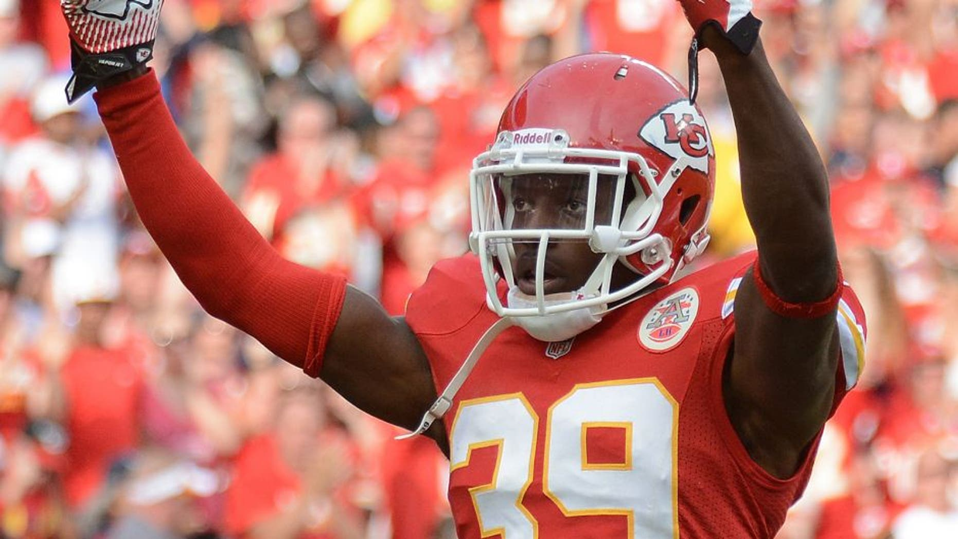 Oct 20, 2013; Kansas City, MO, USA; Kansas City Chiefs defensive back Husain Abdullah (39) motions to the crowd during the first half of the game against the Houston Texans at Arrowhead Stadium. The Chiefs won 17-16. Mandatory Credit: Denny Medley-USA TODAY Sports