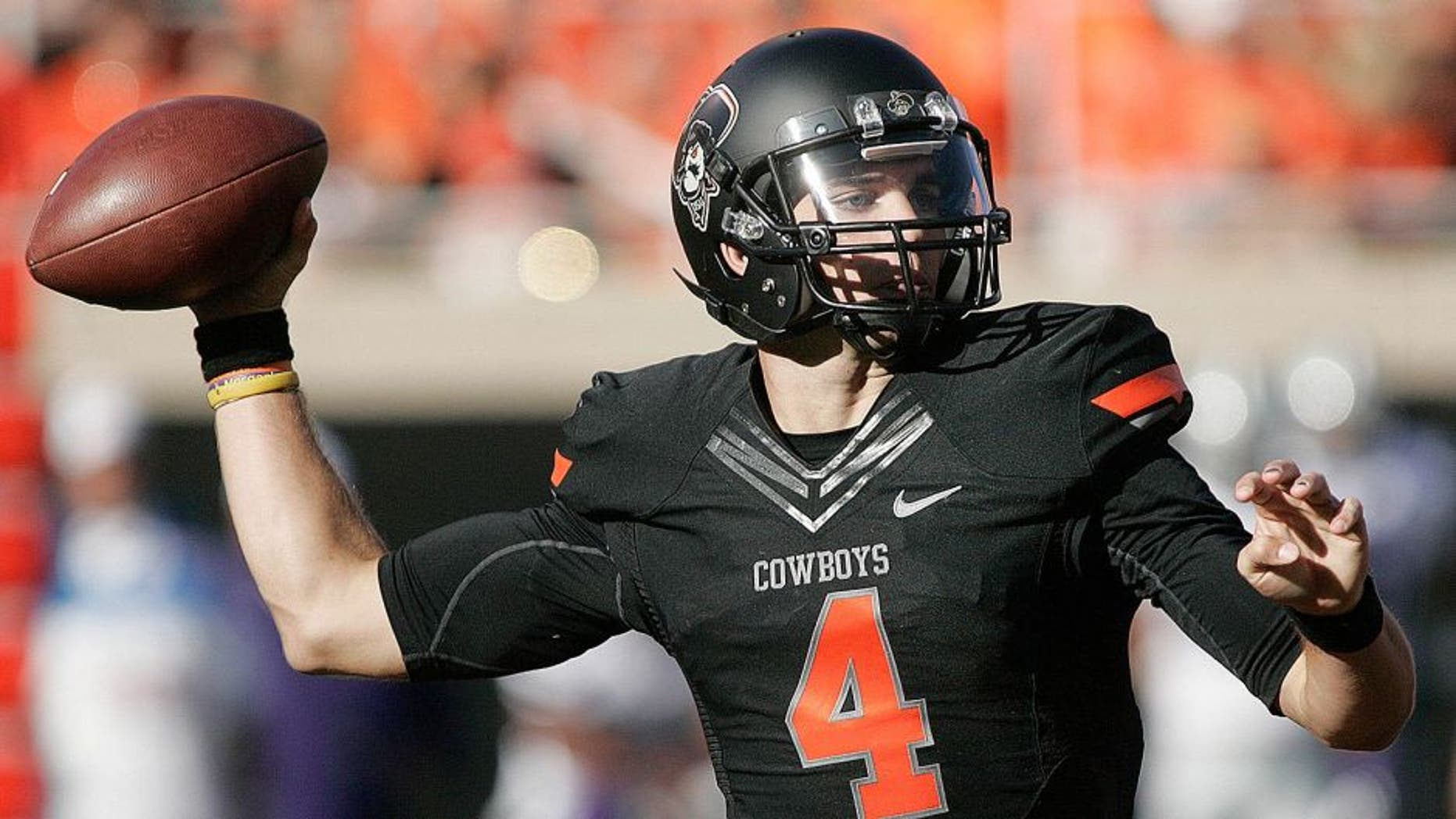 STILLWATER, OK - OCTOBER 5: Quarterback J.W. Walsh #4 of the Oklahoma State Cowboys looks to throw against the Kansas State Wildcats October 5, 2013 at Boone Pickens Stadium in Stillwater, Oklahoma. The Cowboys defeated the Wildcats 33-29. (Photo by Brett Deering/Getty Images)