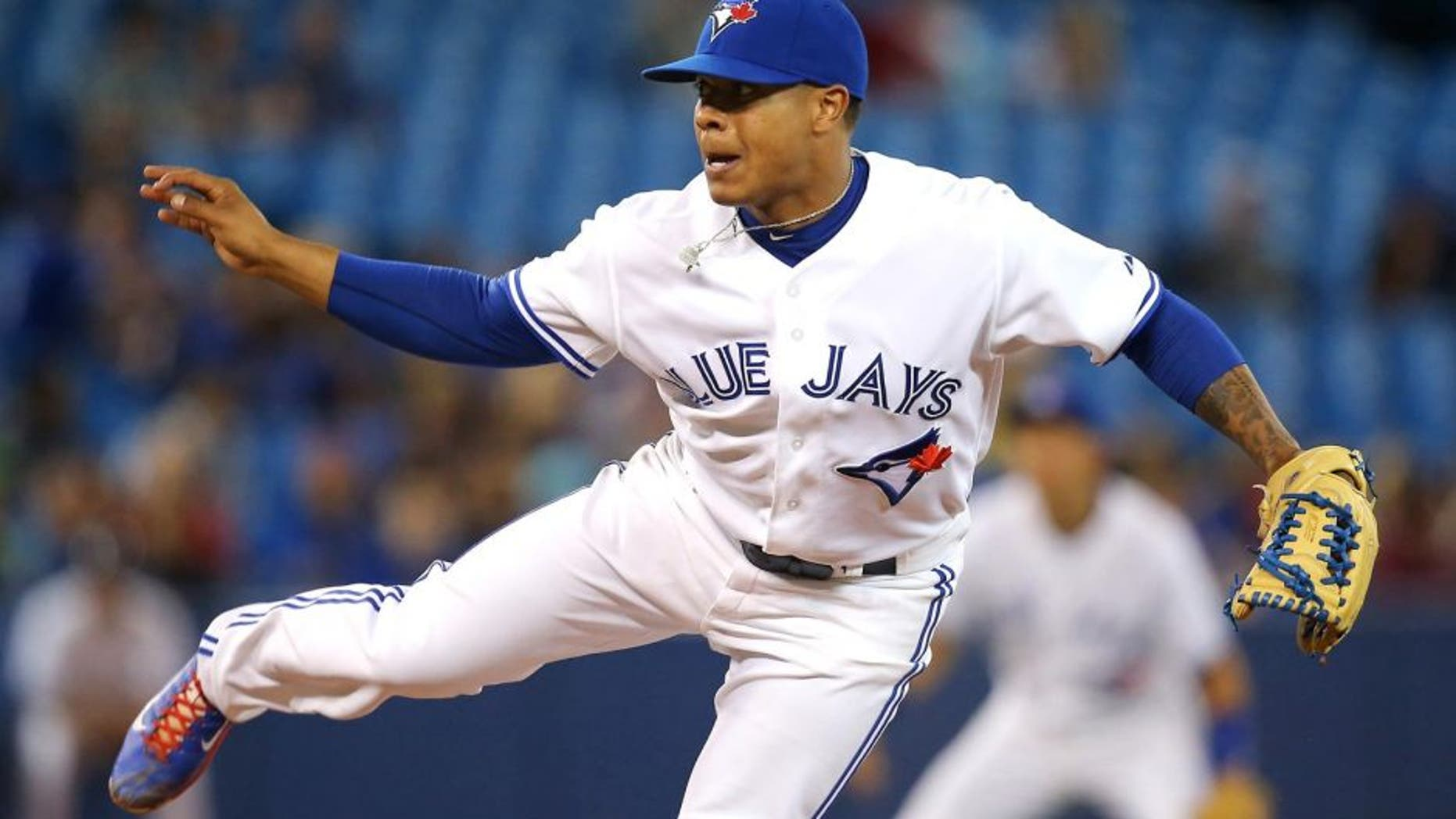 TORONTO, CANADA - SEPTEMBER 26: Marcus Stroman #54 of the Toronto Blue Jays delivers a pitch during MLB game action against the Baltimore Orioles on September 26, 2014 at Rogers Centre in Toronto, Ontario, Canada. (Photo by Tom Szczerbowski/Getty Images)