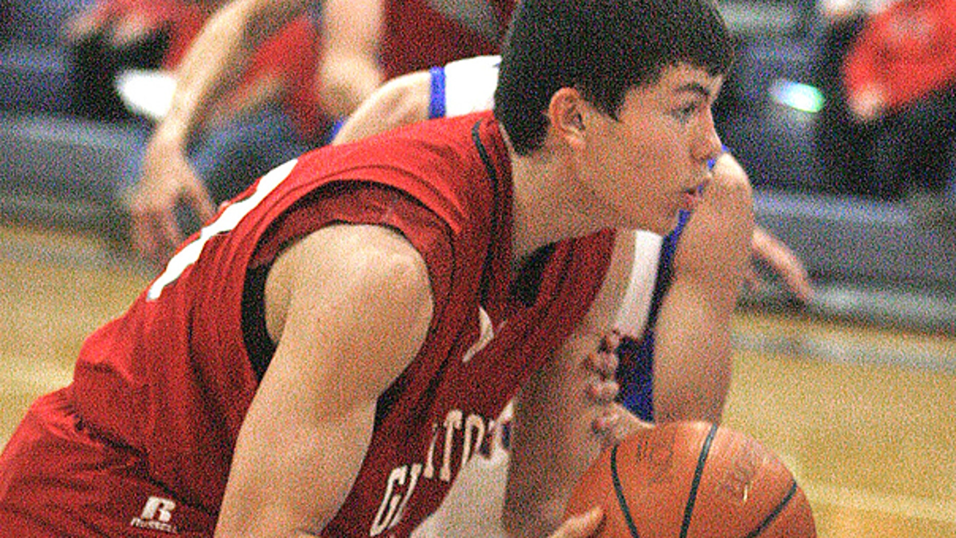 In this Feb. 1, 2011, photo, Roma High School's Robert Garza moves to the net in a game with with Veterans Memorial High School in Mission, Texas.