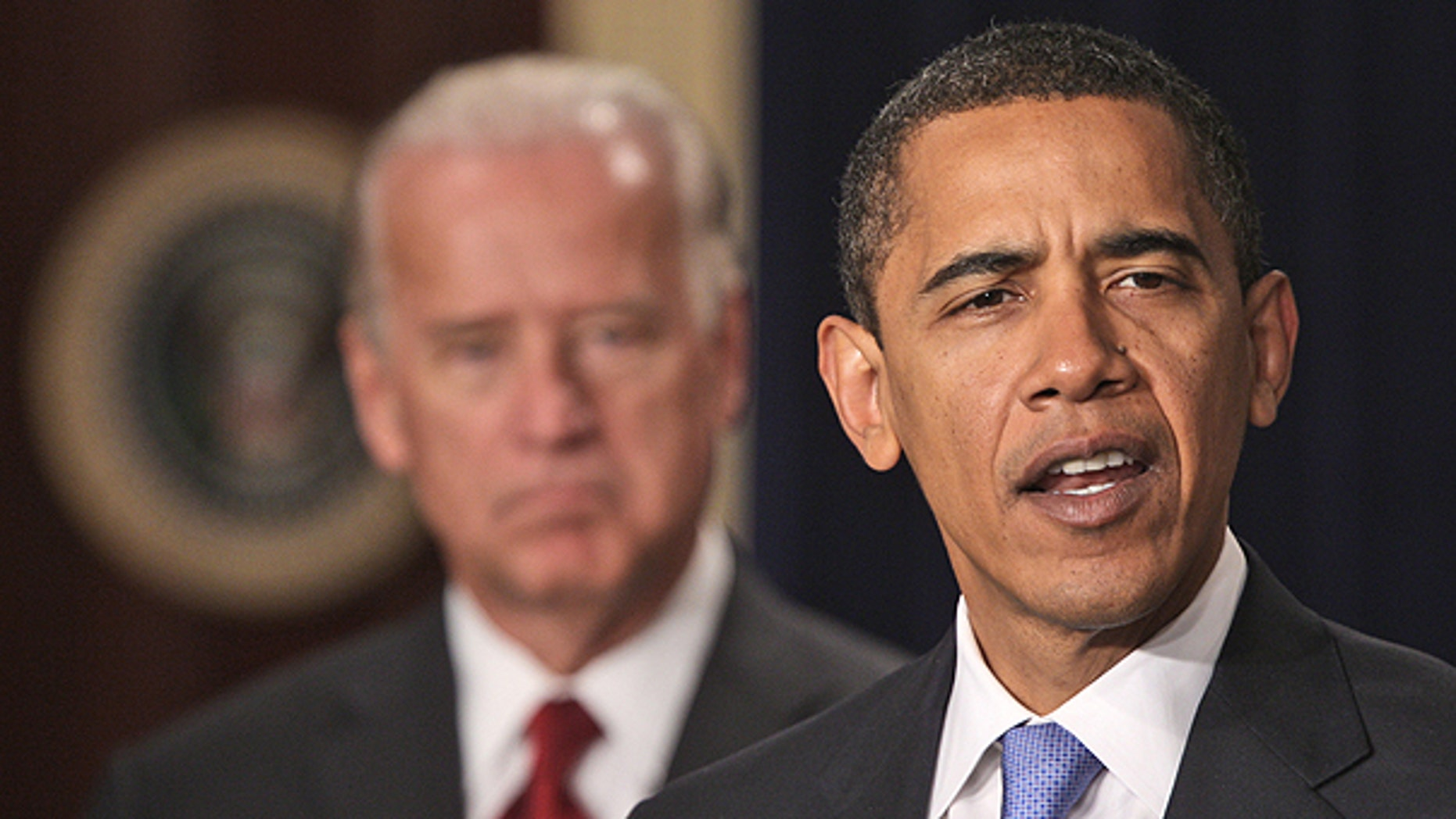 In this Jan. 21, 2009 file photo, President Barack Obama, accompanied by Vice President Joe Biden speaks in the Eisenhower Executive Office Building in Washington.