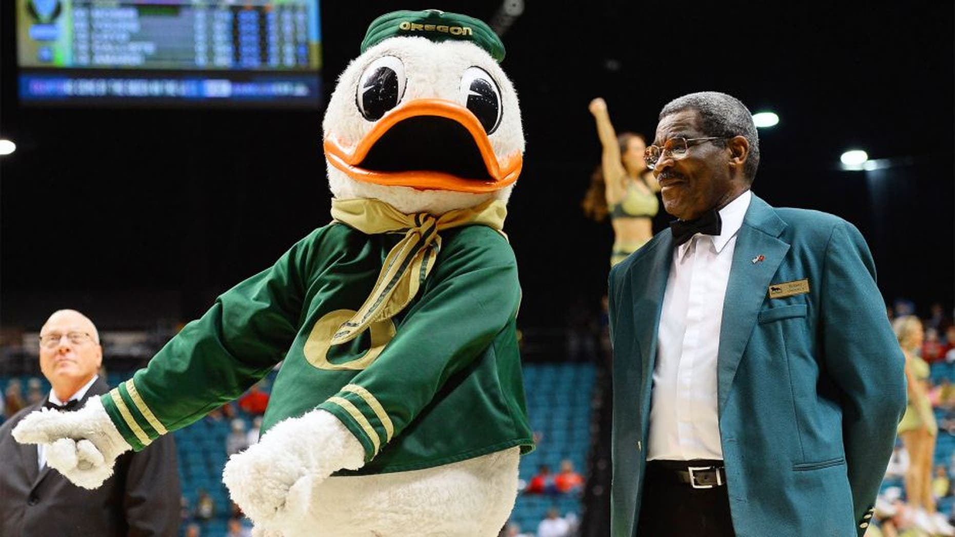 LAS VEGAS, NV - MARCH 12: Oregon Ducks mascot The Duck jokes around with World Boxing Hall of Fame and California Boxing Hall of Fame referee Robert Byrd, an MGM Grand usher, during a first-round game of the Pac-12 Basketball Tournament against the Oregon State Beavers at the MGM Grand Garden Arena on March 12, 2014 in Las Vegas, Nevada. Oregon won 88-74. (Photo by Ethan Miller/Getty Images)